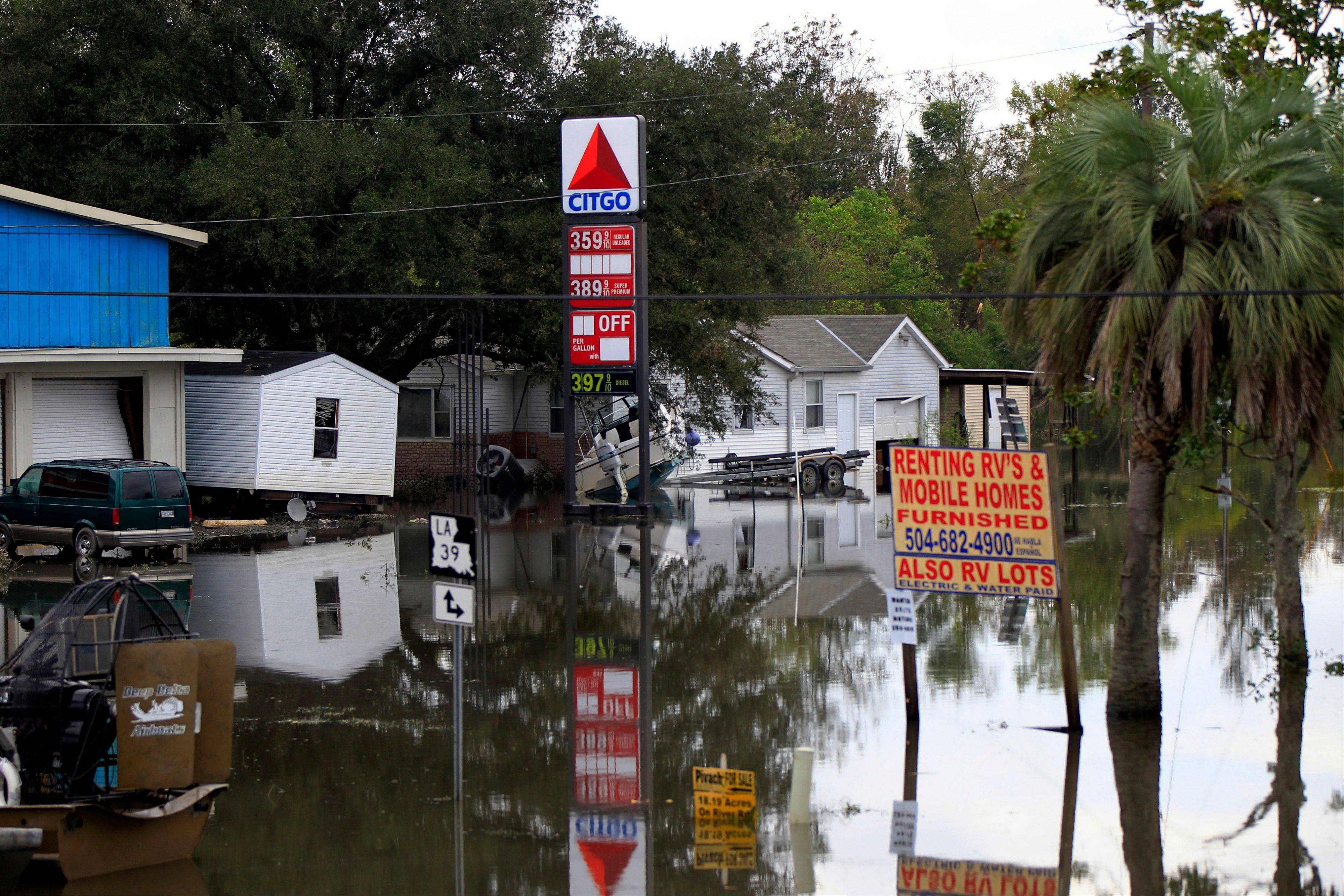Floodwaters from Hurricane Isaac inundate structures in Scaresdale , La., Sunday. More than 200,000 people across Louisiana still didn't have any power five days after Hurricane Isaac ravaged the state. Thousands of evacuees remained at shelters or bunked with friends or relatives.