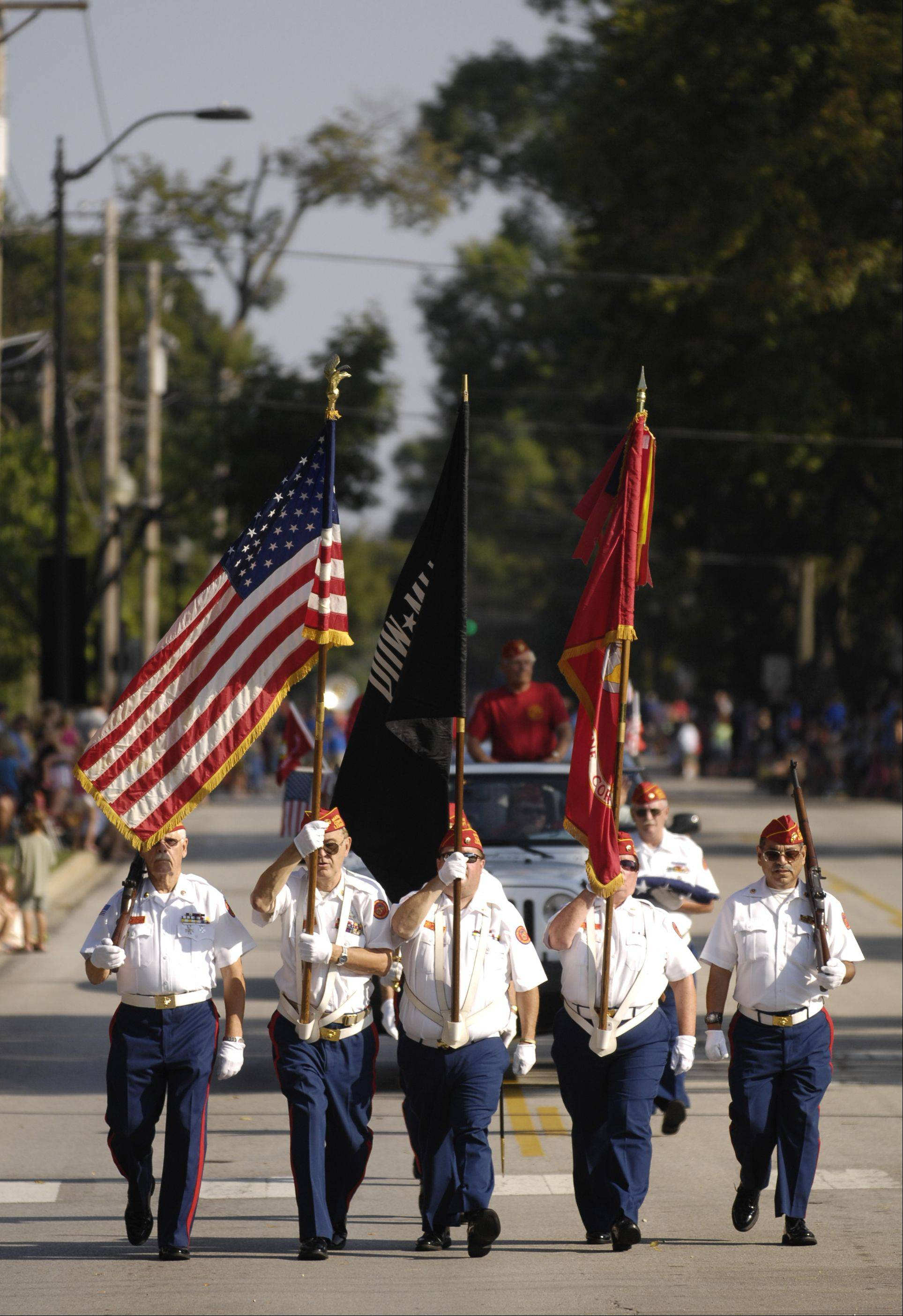 The DuPage County Marines, World War II Veterans march in the rescheduled Wheaton Fourth of July parade on Labor Day. The parade was rescheduled because of storm damage from July 1.
