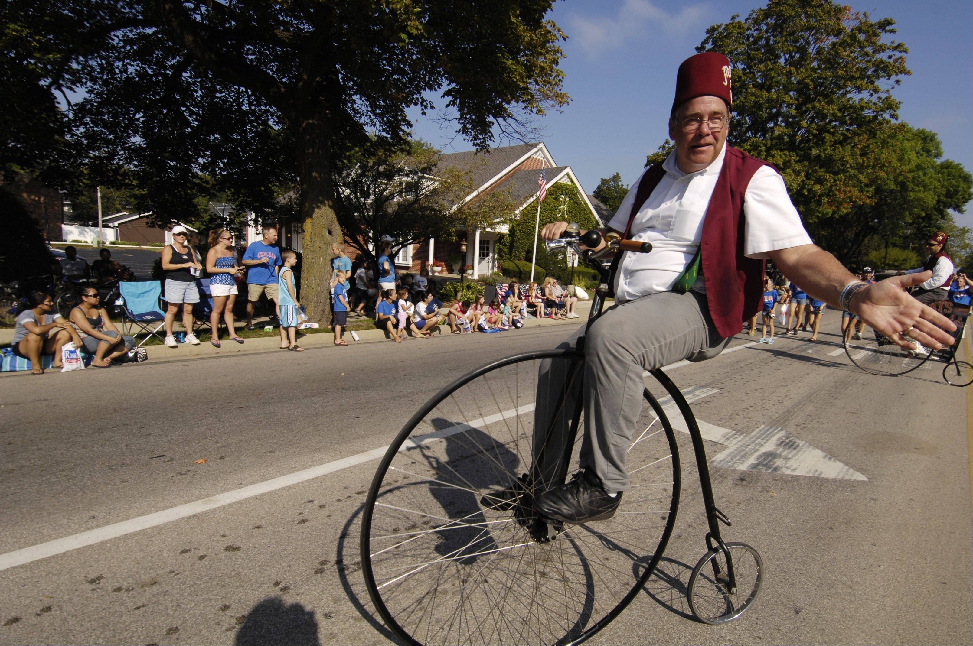 "Members of the Medinah Shriners ""Big Wheels"" perform in the rescheduled Wheaton Fourth of July parade on Labor Day. The parade was rescheduled because of storm damage from July 1."