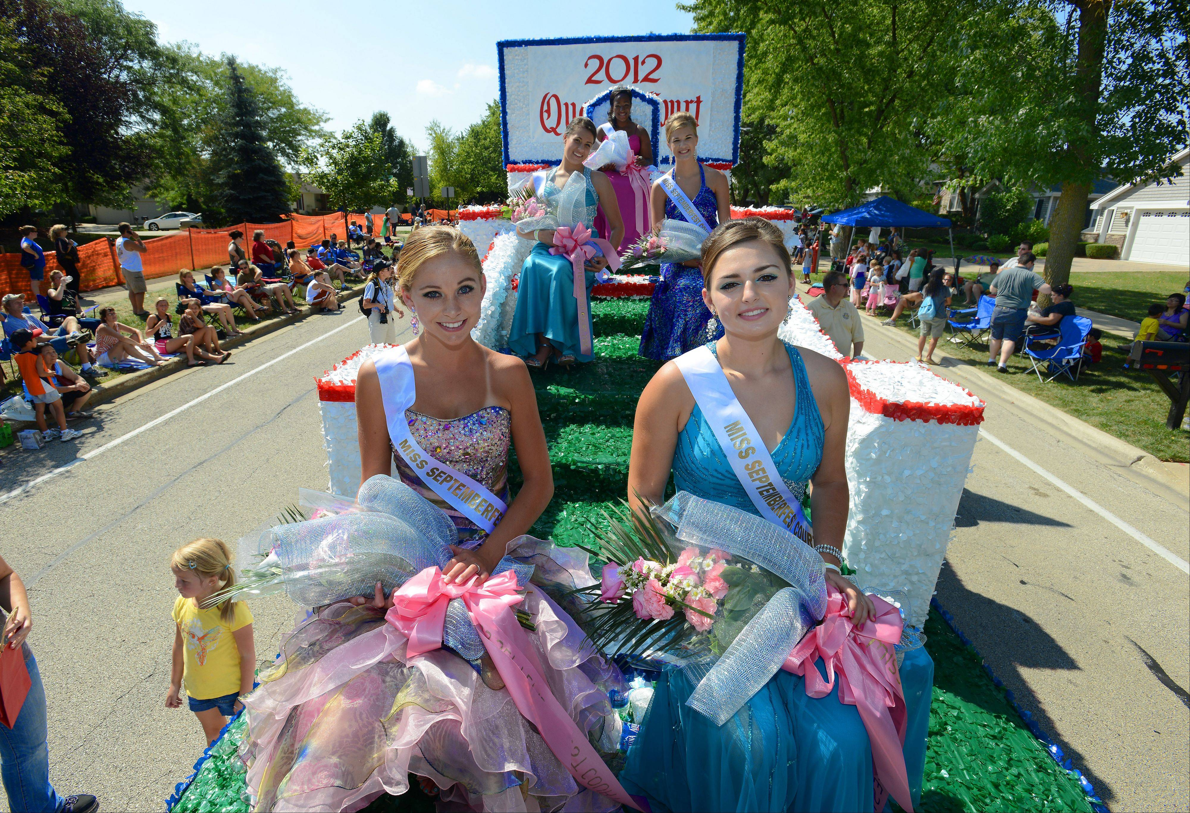 The 2012 Schaumburg Septemberfest queen and her court participate in the parade Monday.