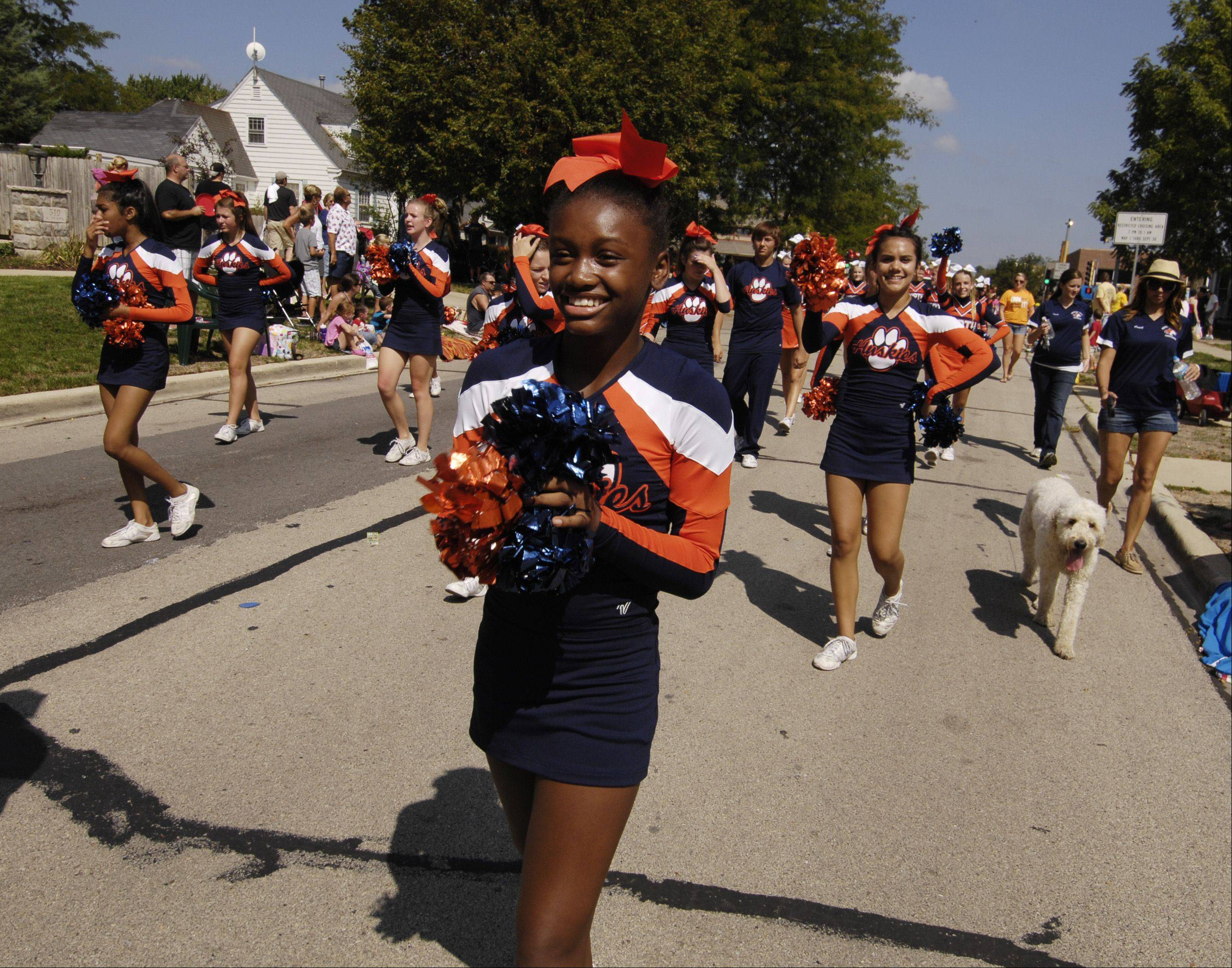 The Naperville North cheerleaders march in the Naperville Labor Day Parade on Monday.