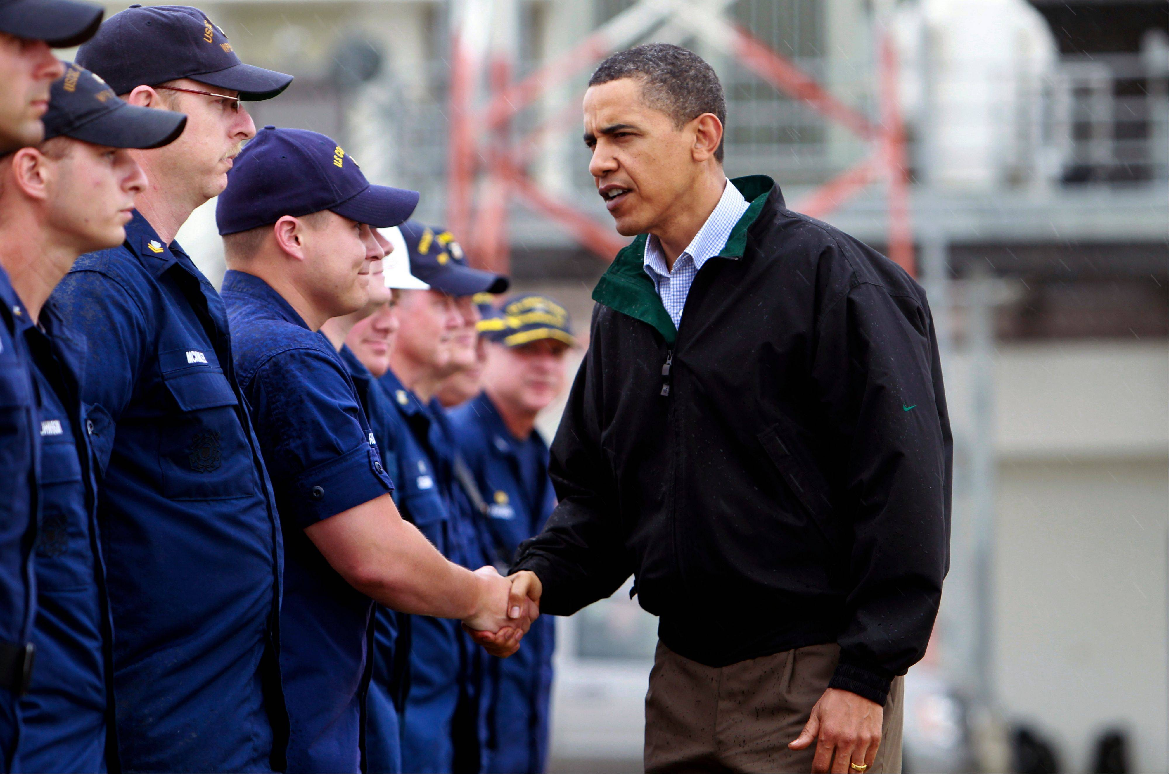 In this May 2, 2010, file photo, President Barack Obama meets coast guard first responders in Venice, La., as he visits the Gulf Coast region affected by the BP (British Petroleum) oil well spill. President Obama tweaked his travel plans to head to Louisiana on Monday, Sept. 3, 2012, to see the damage from Hurricane Isaac ahead of his own nominating convention -- shortly after Republican presidential candidate Mitt Romney toured the area.