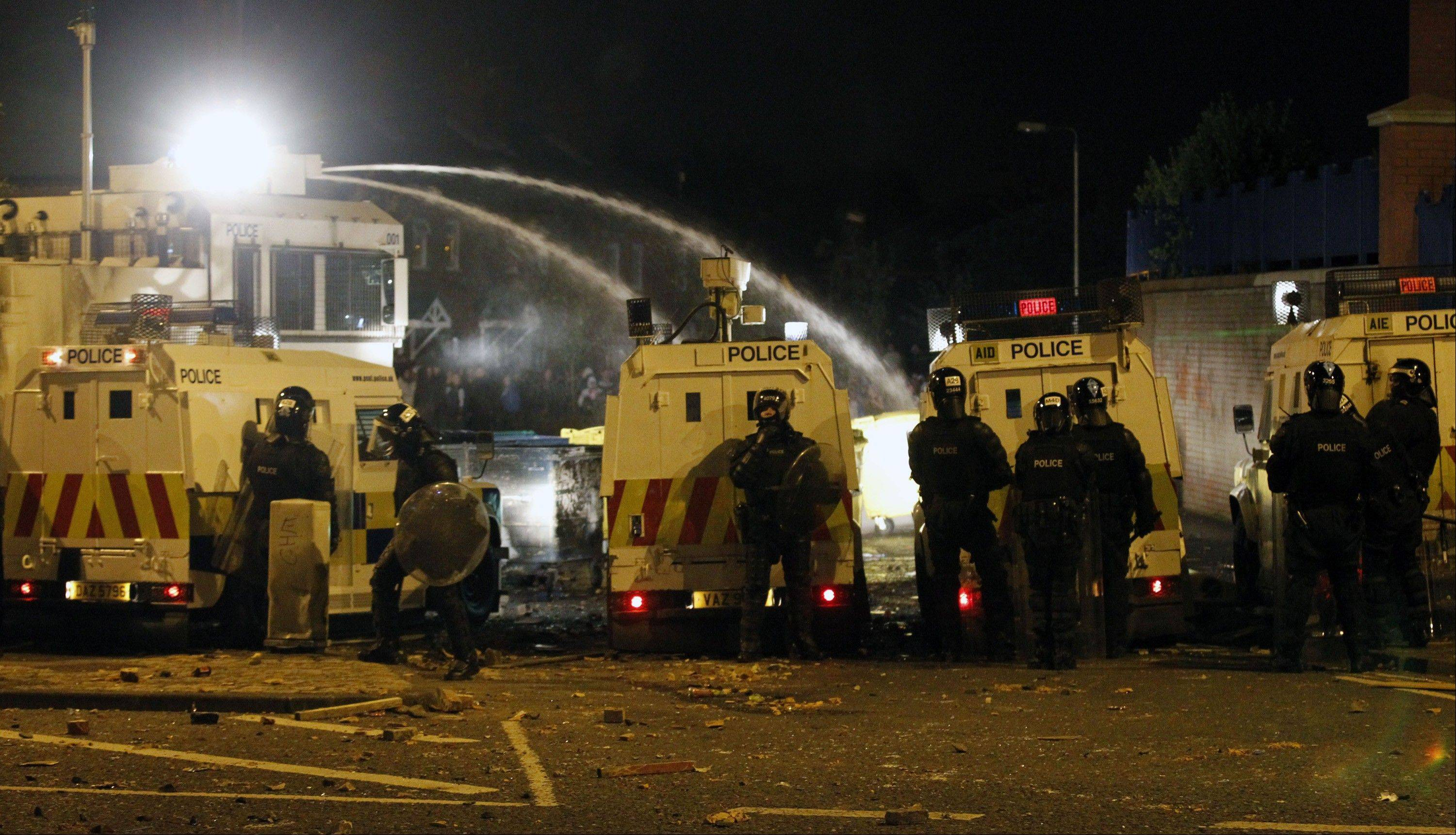 Police use a water cannon on loyalist rioters in North Belfast, Northern Ireland, Sunday, Sept. 2, 2012. A number of police were injured during a night of clashes. The violence came after unrest at marches in the area the previous weekend.