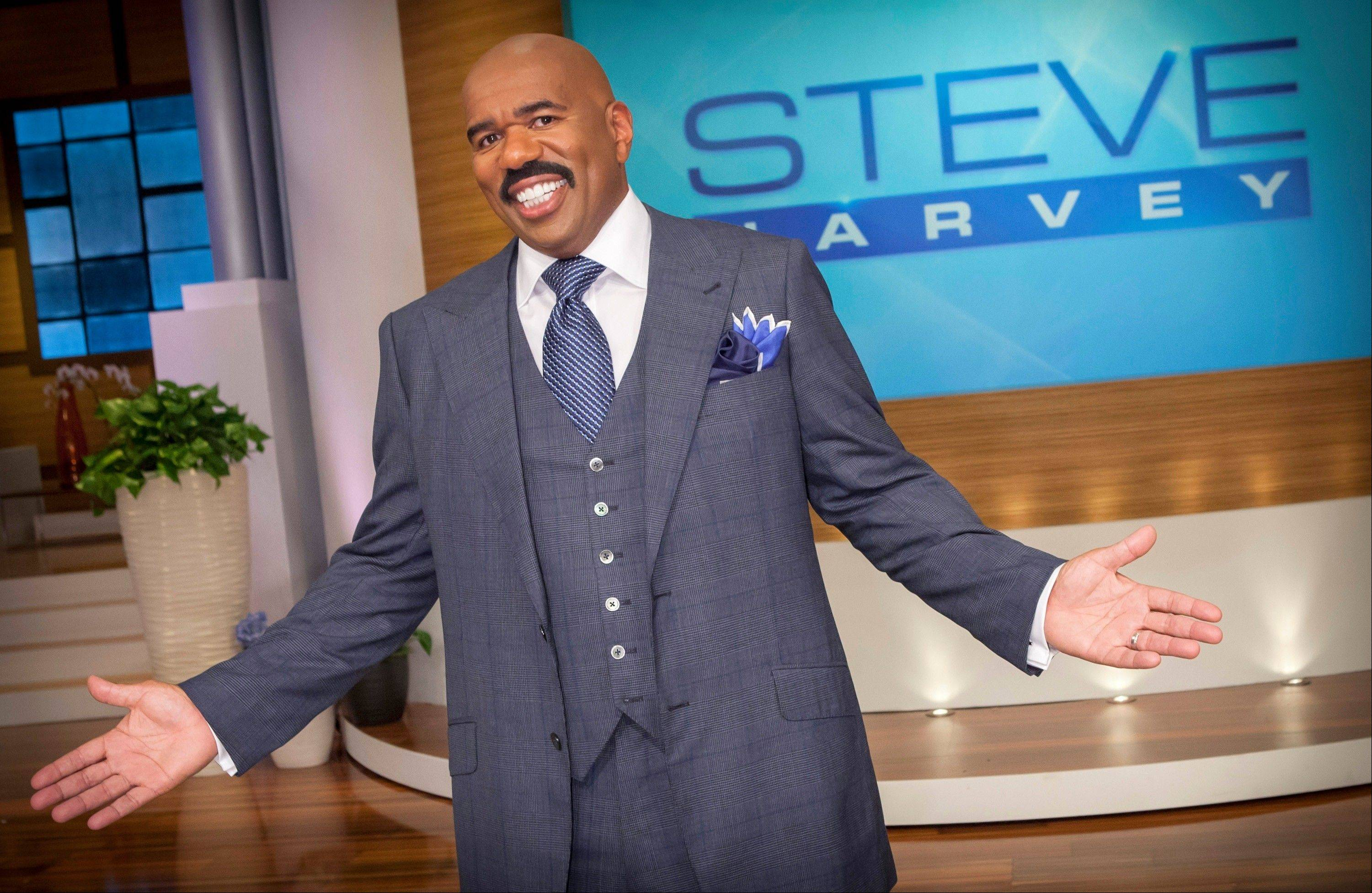 "In this August 2012 photo provided by NBC, host Steve Harvey stands on the set of his new talk show ""The Steve Harvey Show,"" in Chicago. The veteran comic, whose new show gets a jump on the fall season Tuesday was first approached about a show three years ago, when his first book, ""Act Like a Lady, Think Like a Man,"" was on the best-seller lists."