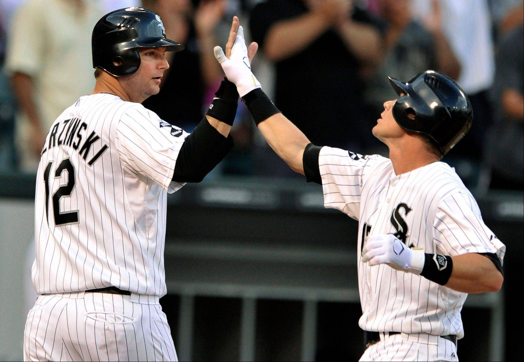 White Sox infielder Gordon Beckham, right, celebrates with catcher A.J. Pierzynski after hitting a two-run home run in the second inning Monday.