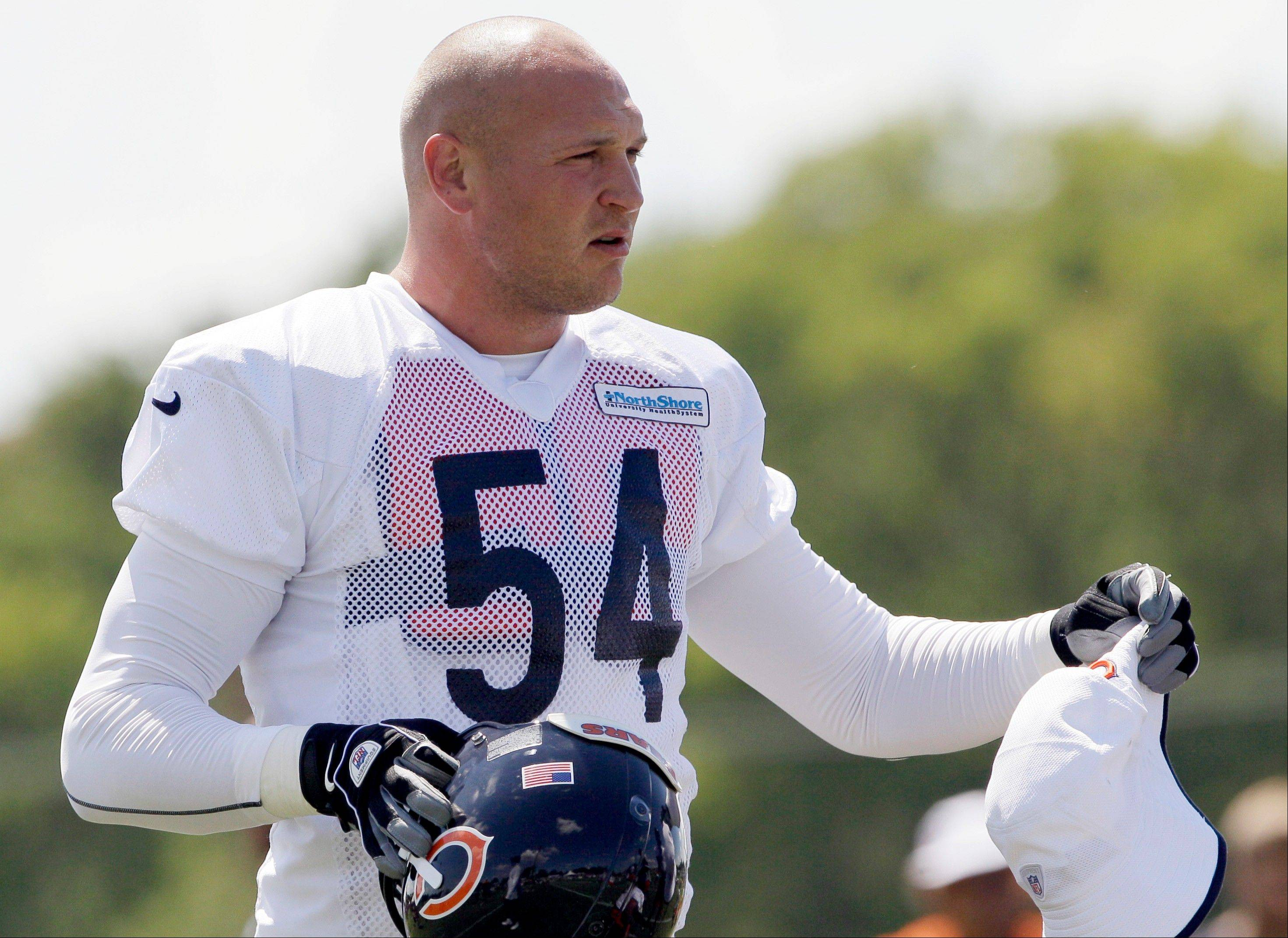 Linebacker Brian Urlacher, here watching teammates practice in late July, returned to the practice field Monday and is expected to be on the field when the Bears open the season Sunday.