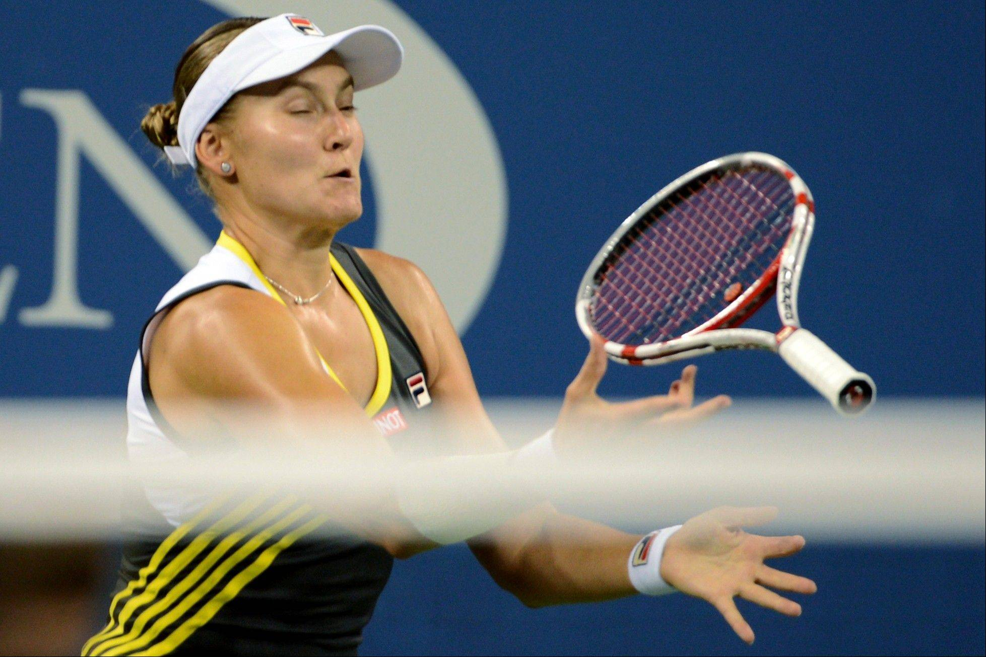 Nadia Petrova, of Russia, catches her racquet after throwing it in the air during her fourth-round match against Maria Sharapova, of Russia, at the U.S. Open tennis tournament, Sunday, Sept. 2, 2012, in New York. Sharapova won 6-1, 4-6, 6-4.