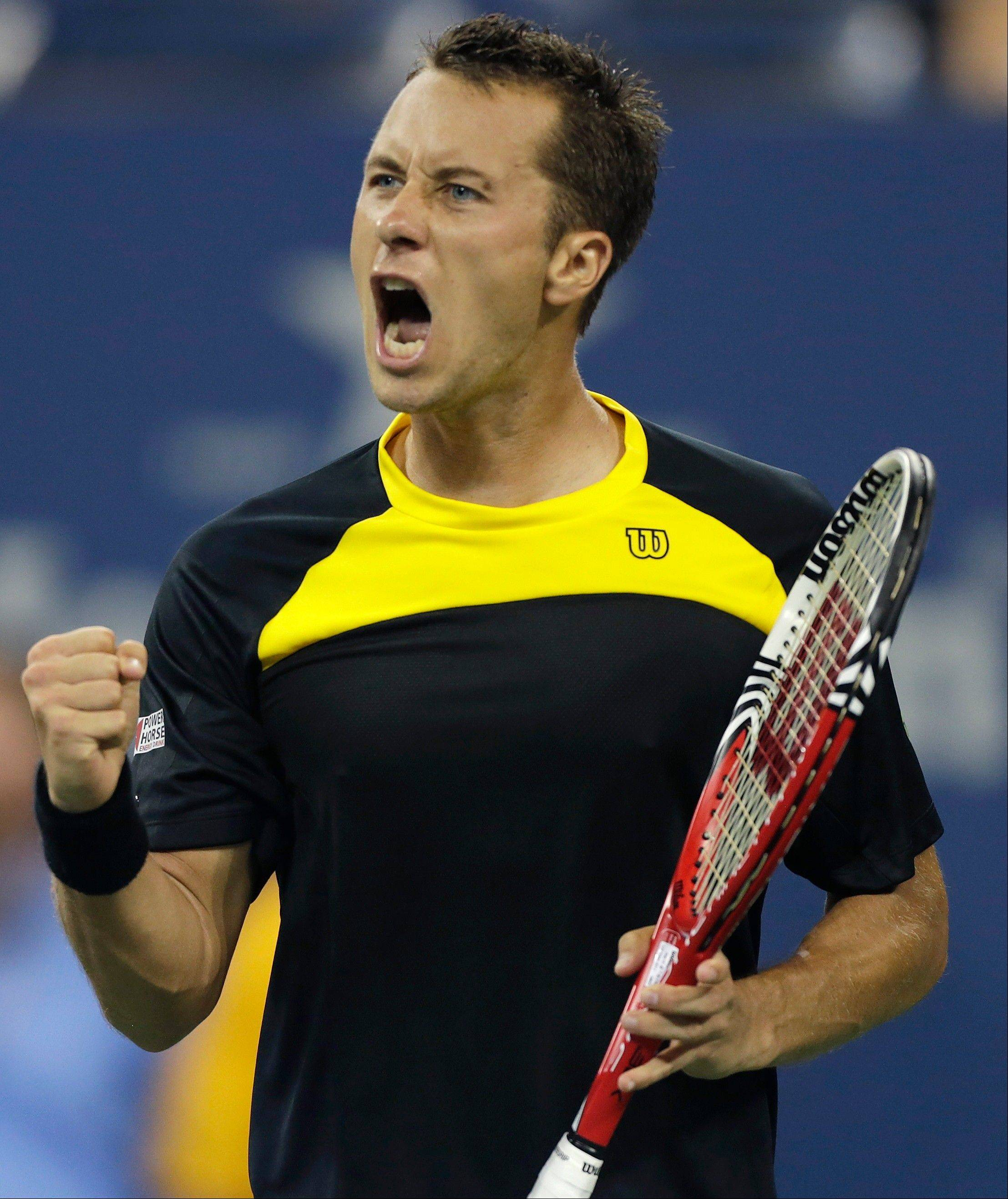 Philipp Kohlschreiber, of Germany, pumps his fist and yells during the fifth set against John Isner in the third round of play at the 2012 US Open tennis tournament, early Monday, Sept. 3, 2012 in New York. Kohlschreiber won 6-4, 3-6, 4-6, 6-3, 6-4. The match began on Sunday evening.