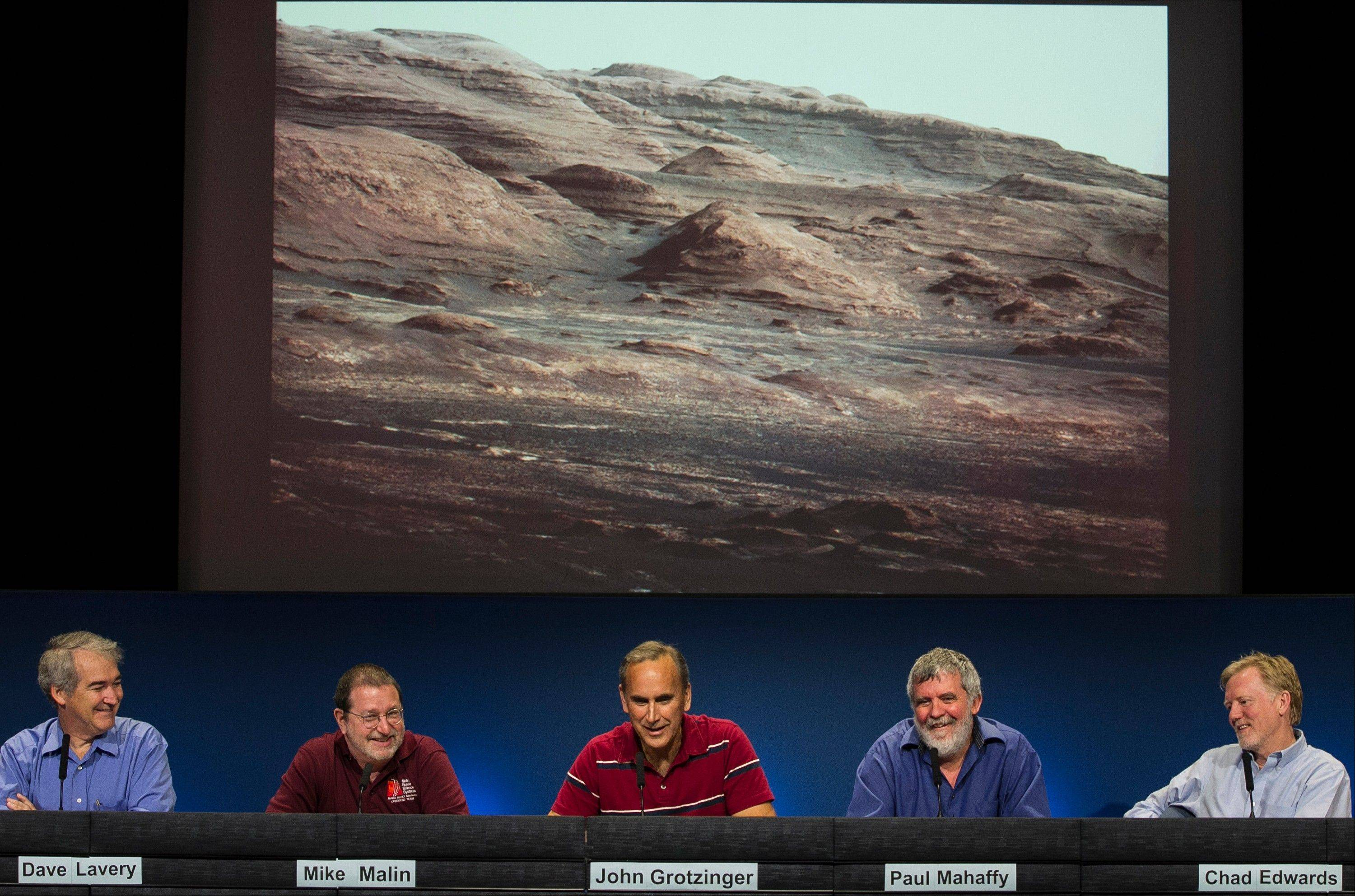 NASA scientists face the press and talk about the Curiosity rover's performance and mission at NASA's Jet Propulsion Laboratory in Pasadena, Calif.