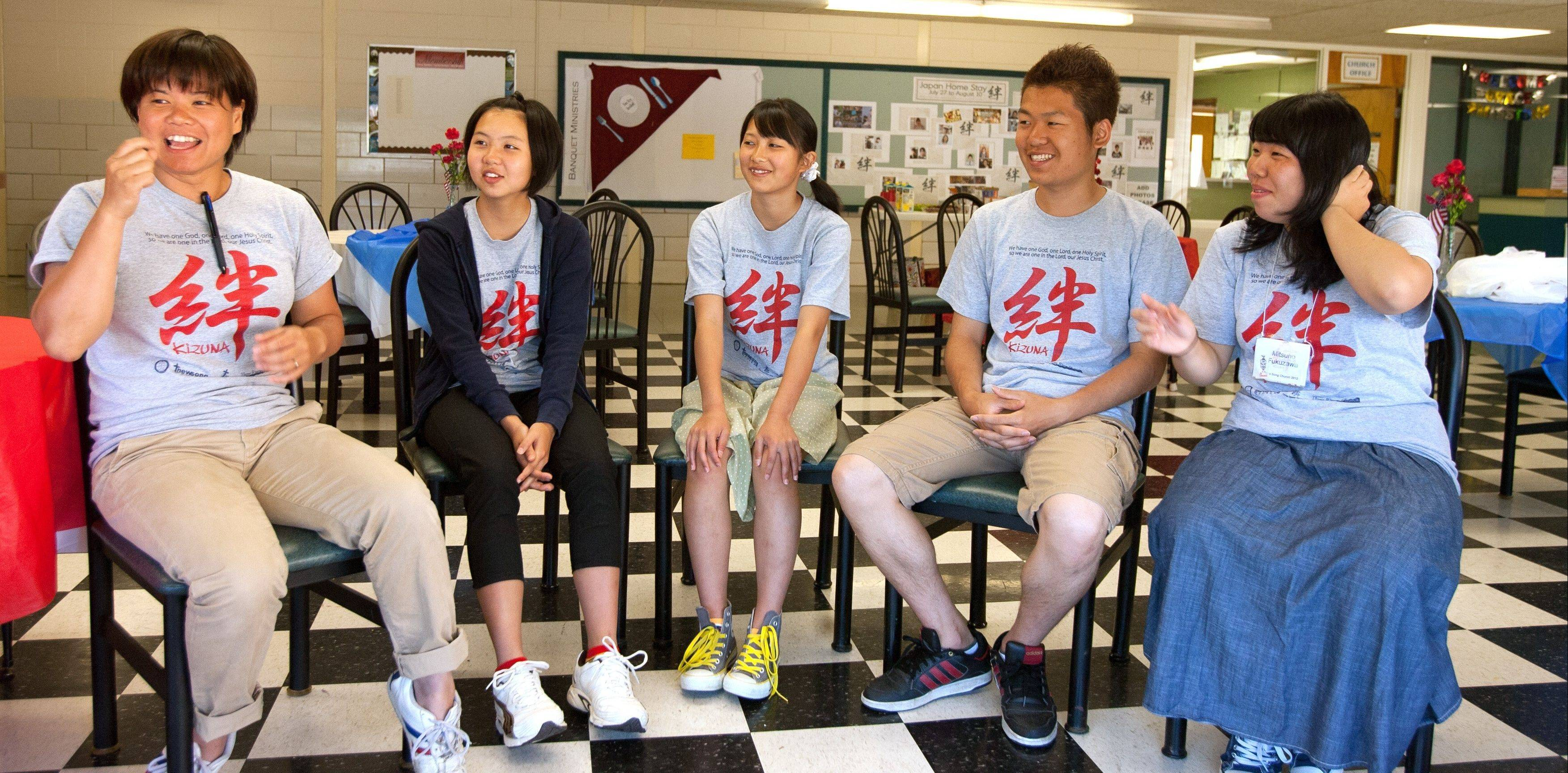 From left to right, Pastor Kyouko Yonaha talks with Haruka Hikithi, 13; Ai Higuchi, 15; Yoshiyuki Aoto, 18; and Mitsuho Fukuzawa, 16 at the New Song Church in Bolingbrook.