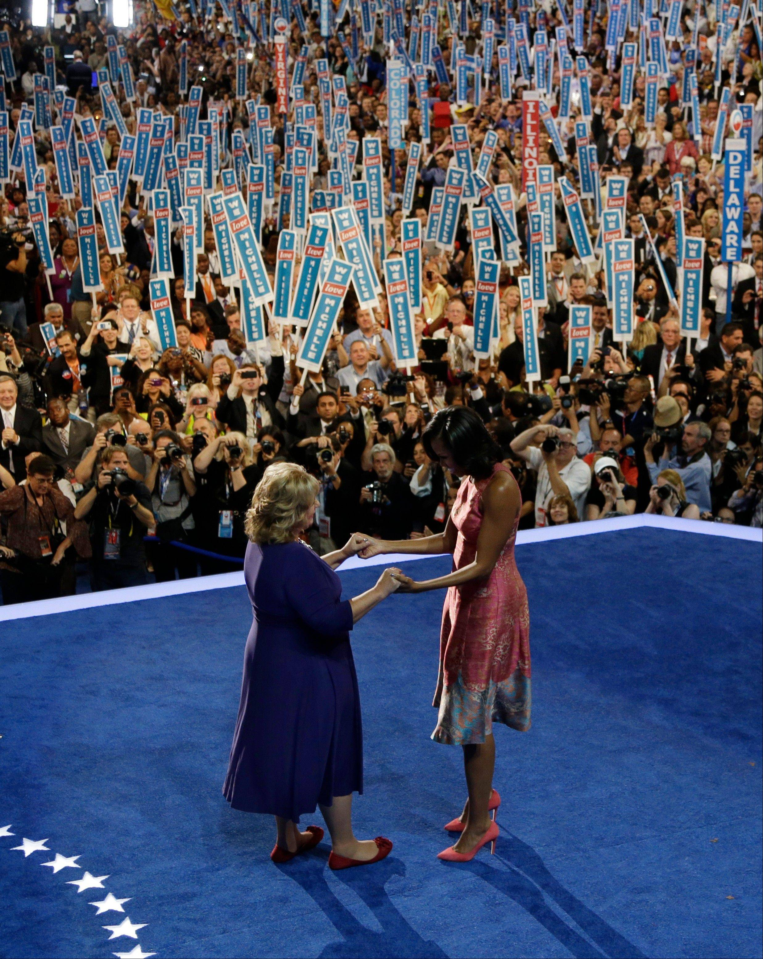 First Lady Michelle Obama, right, is greeted by Elaine Brye at the Democratic National Convention in Charlotte, N.C., on Tuesday, Sept. 4, 2012.