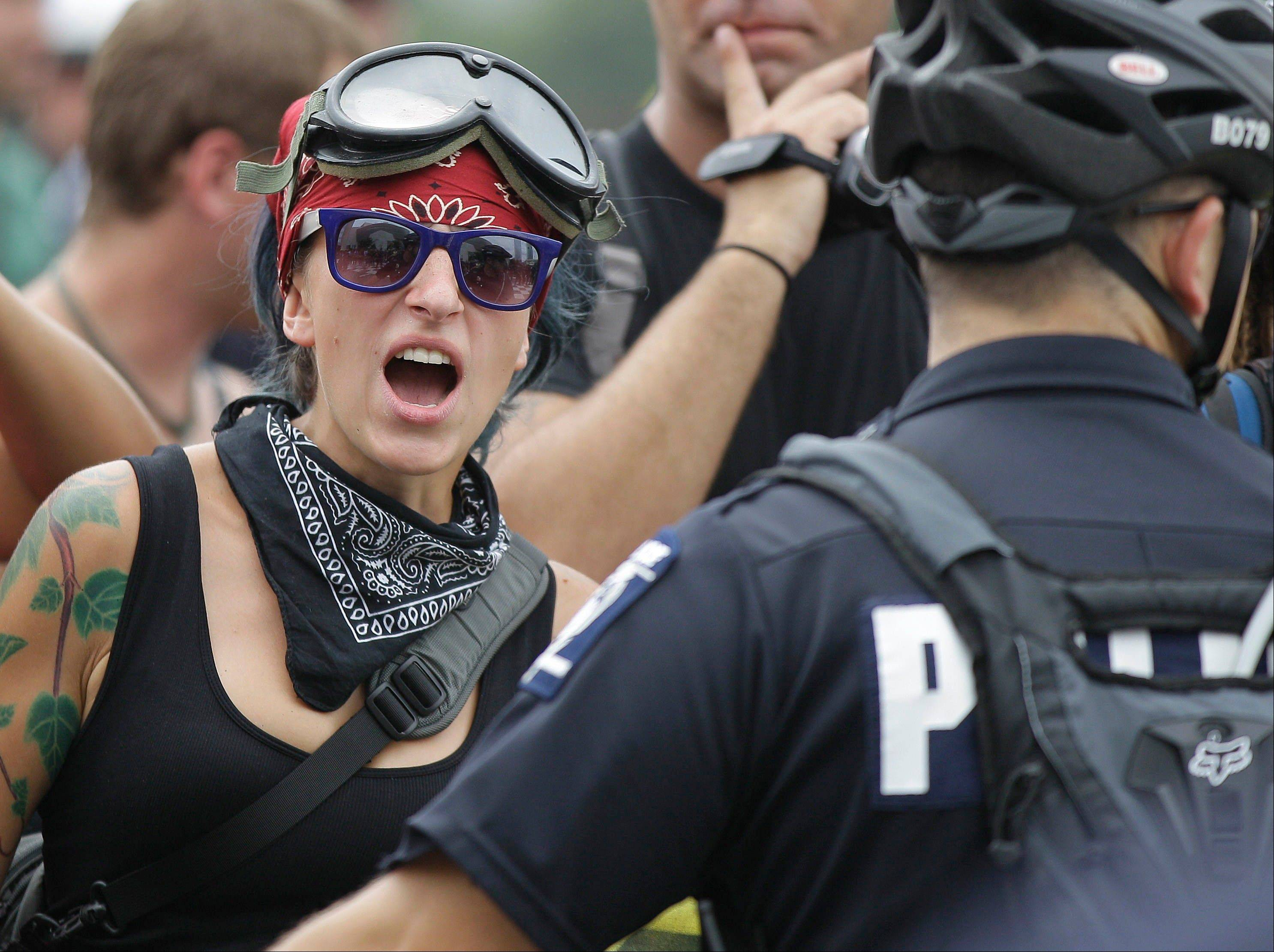 Occupy demonstrators shout at police during an unscheduled protest march Tuesday in Charlotte, N.C., where the Democratic National Convention was to begin in hours.