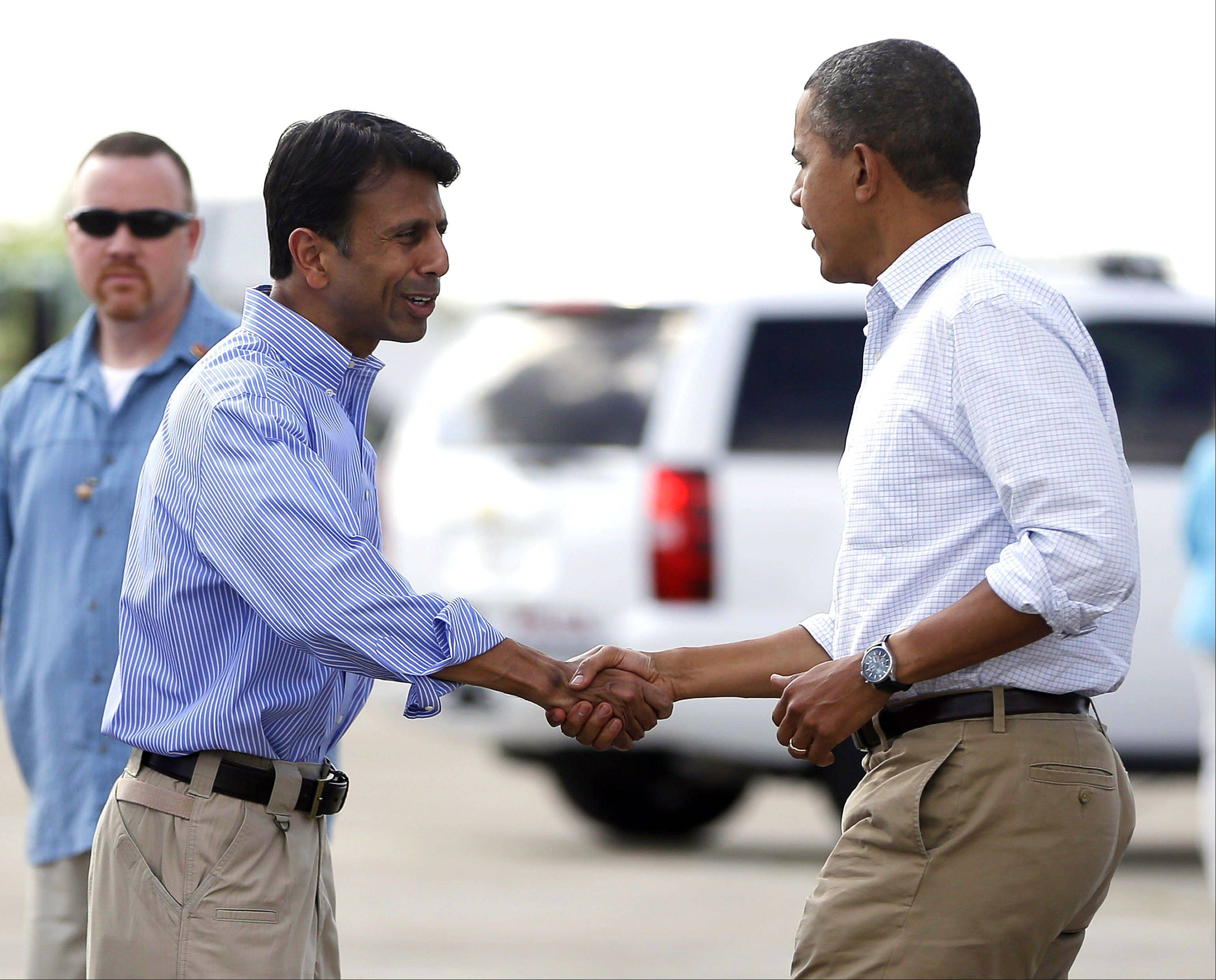 President Barack Obama is greeted on the tarmac by Gov. Bobby Jindal, during his arrival in New Orleans Monday. Obama traveled to the region to view the ongoing response and recovery efforts to Hurricane Isaac.