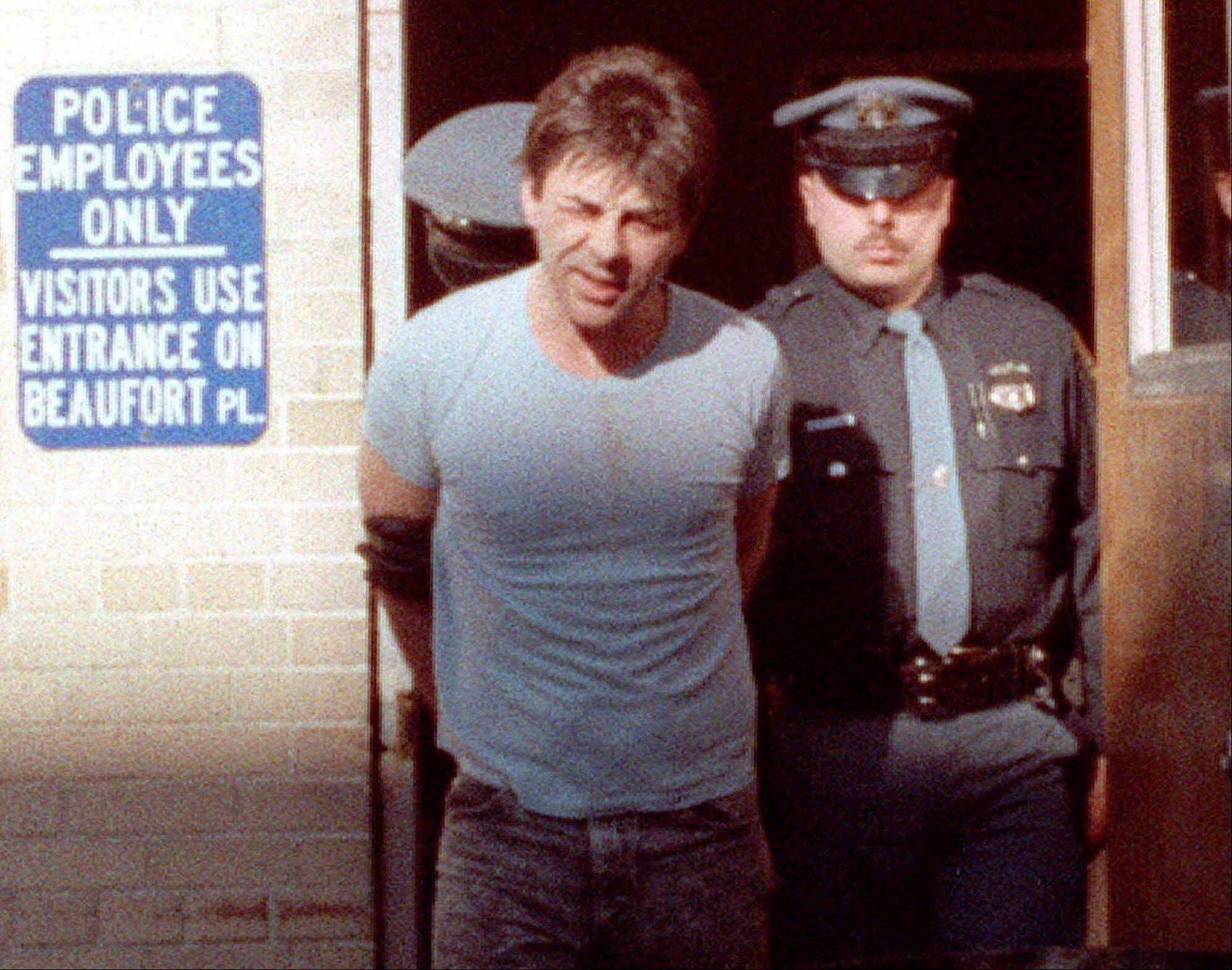 Robert Kosilek is led to the county jail following his arraignment on drunken driving charges, in New Rochelle, N.Y., in 1990. Kosilek was convicted in the 1990 murder of his wife in Massachusetts, and has been living as a woman, Michelle Kosilek, and receiving hormone treatments while serving life in prison in Massachusetts.