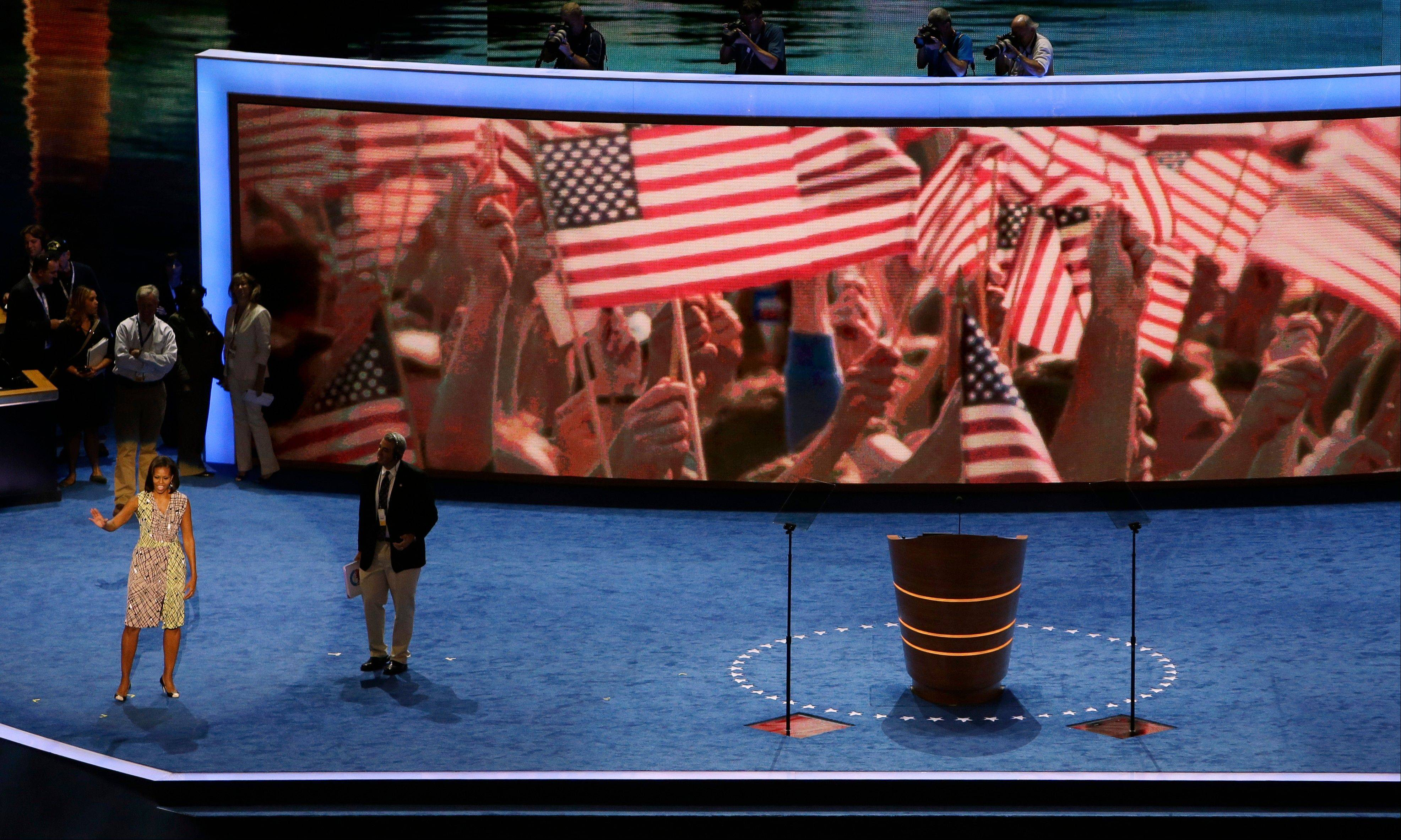 First lady Michelle Obama waves to volunteers during a sound check for the Democratic National Convention in Charlotte, N.C.