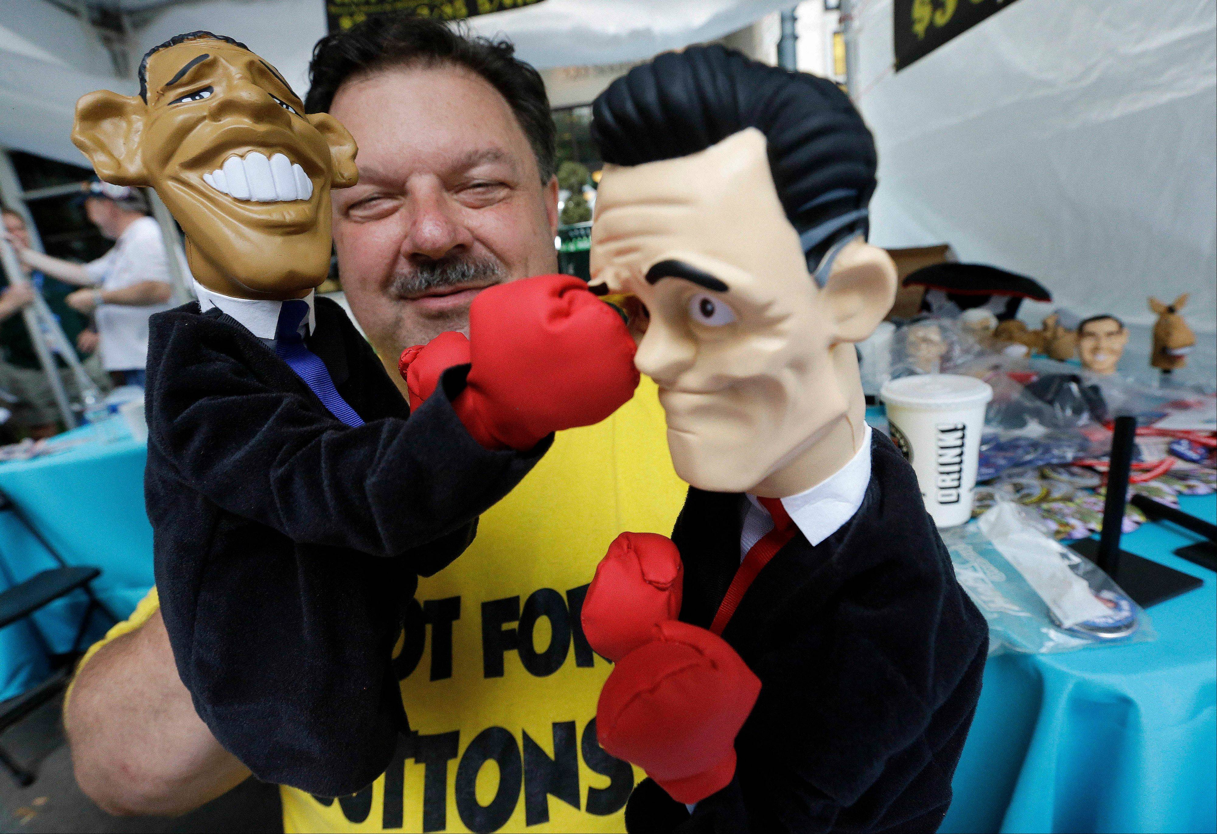 Street vendor Mark Evans shows off his hand puppets in Charlotte, N.C., before the Democratic National Convention.