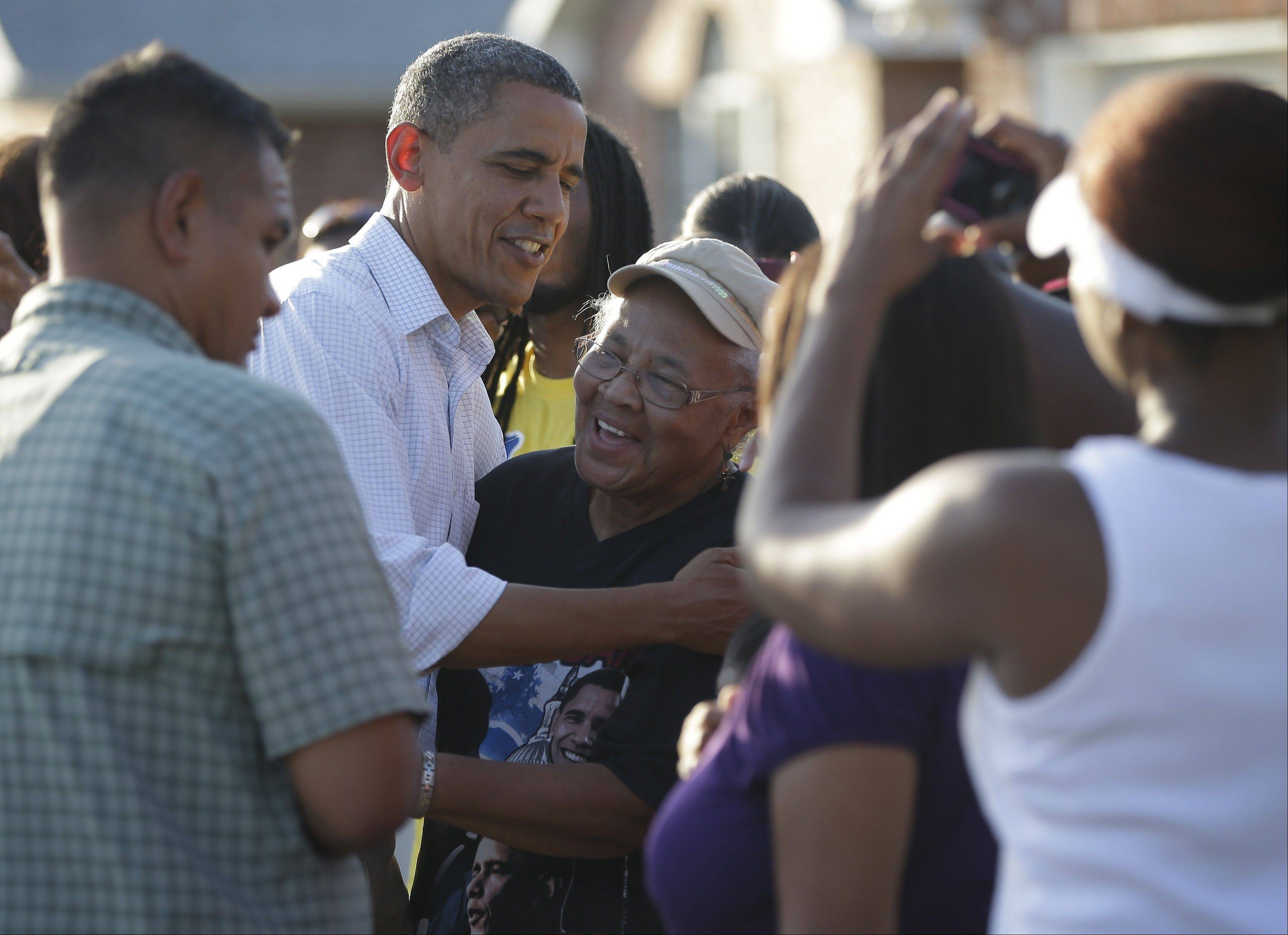 President Barack Obama greets local residents as he tours the Bridgewood neighborhood in LaPlace, La., in the Saint John the Baptist Parish for the ongoing response and recovery efforts to Hurricane Isaac, Monday, Sept. 3, 2012.