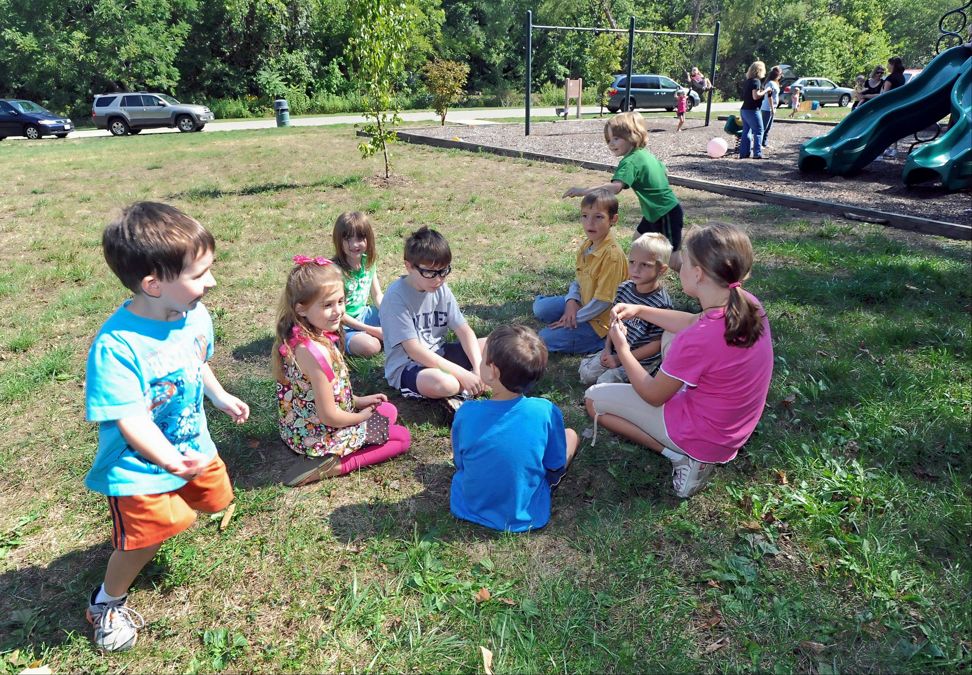 Home-schooled children from the East Central Illinois Home Educators Network play duck, duck, goose during a play day at Kiwanis Park in Charleston, Ill. ECIHEN is a home-school support group with more than 40 member families. The organization officially meets once a month to build relationships among group members, talk about curriculum, see what other families are doing and host social activities.