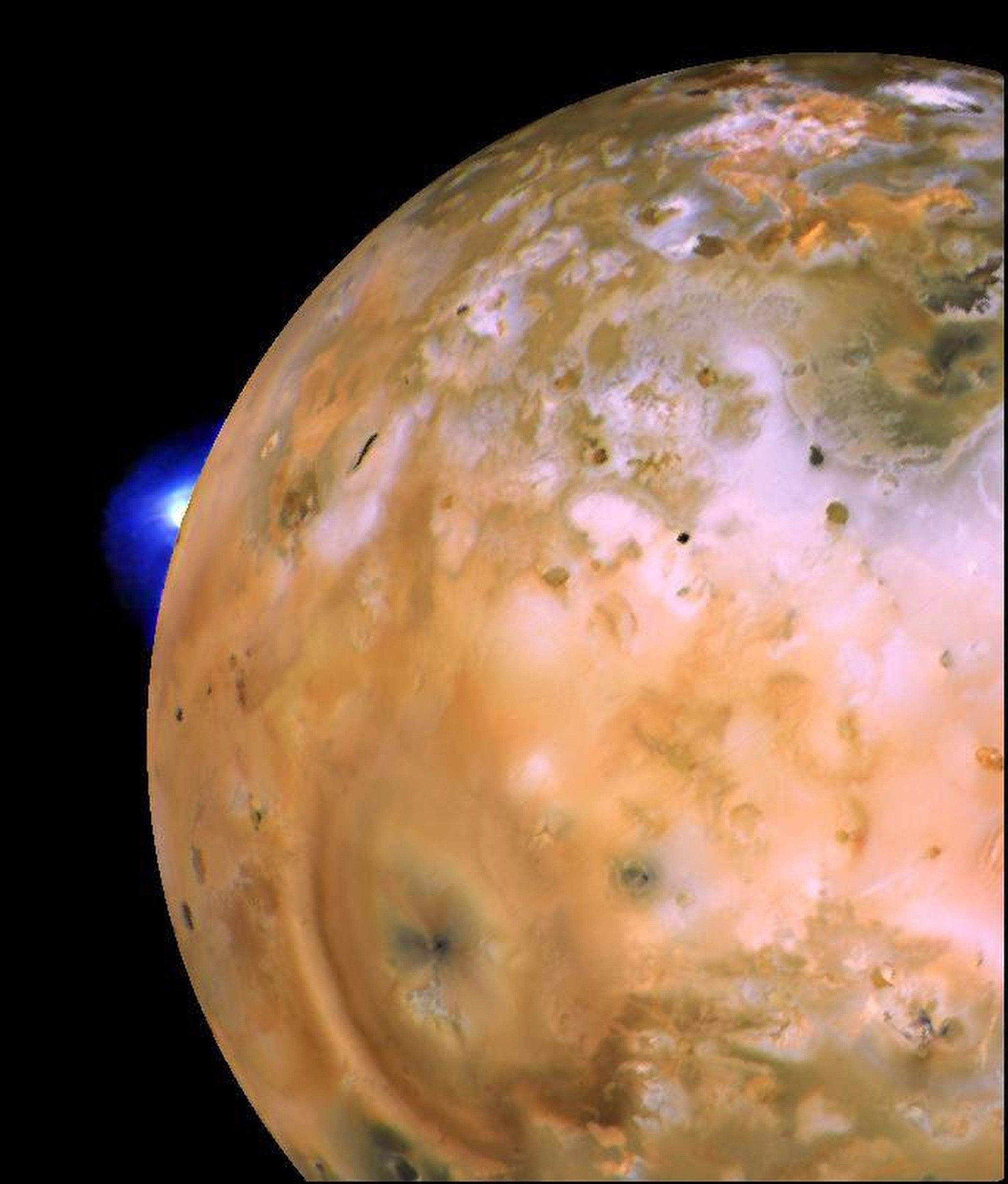 This image provided by NASA shows an image taken by the Voyager 1 spacecraft showing a volcanic plume on the Jupiter moon Io. Launched in 1977, the twin spacecraft are exploring the edge of the solar system. Voyager 1 is poised to cross into interstellar space.