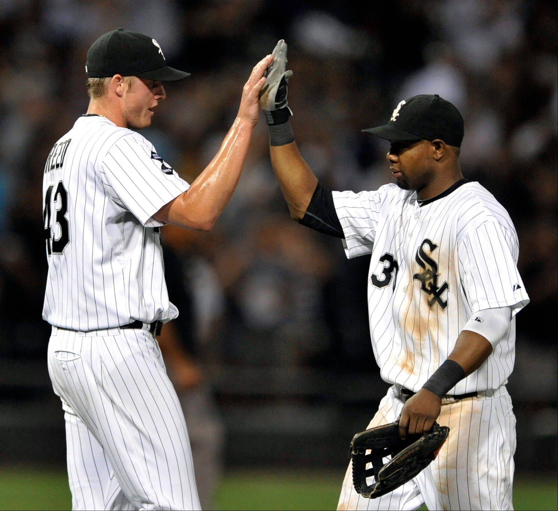 Chicago White Sox closing pitcher Addison Reed, left, celebrates with teammate Alejandro De Aza right, after defeating the Minnesota Twins 4-2 last night back in Chicago after getting swept in Detroit.