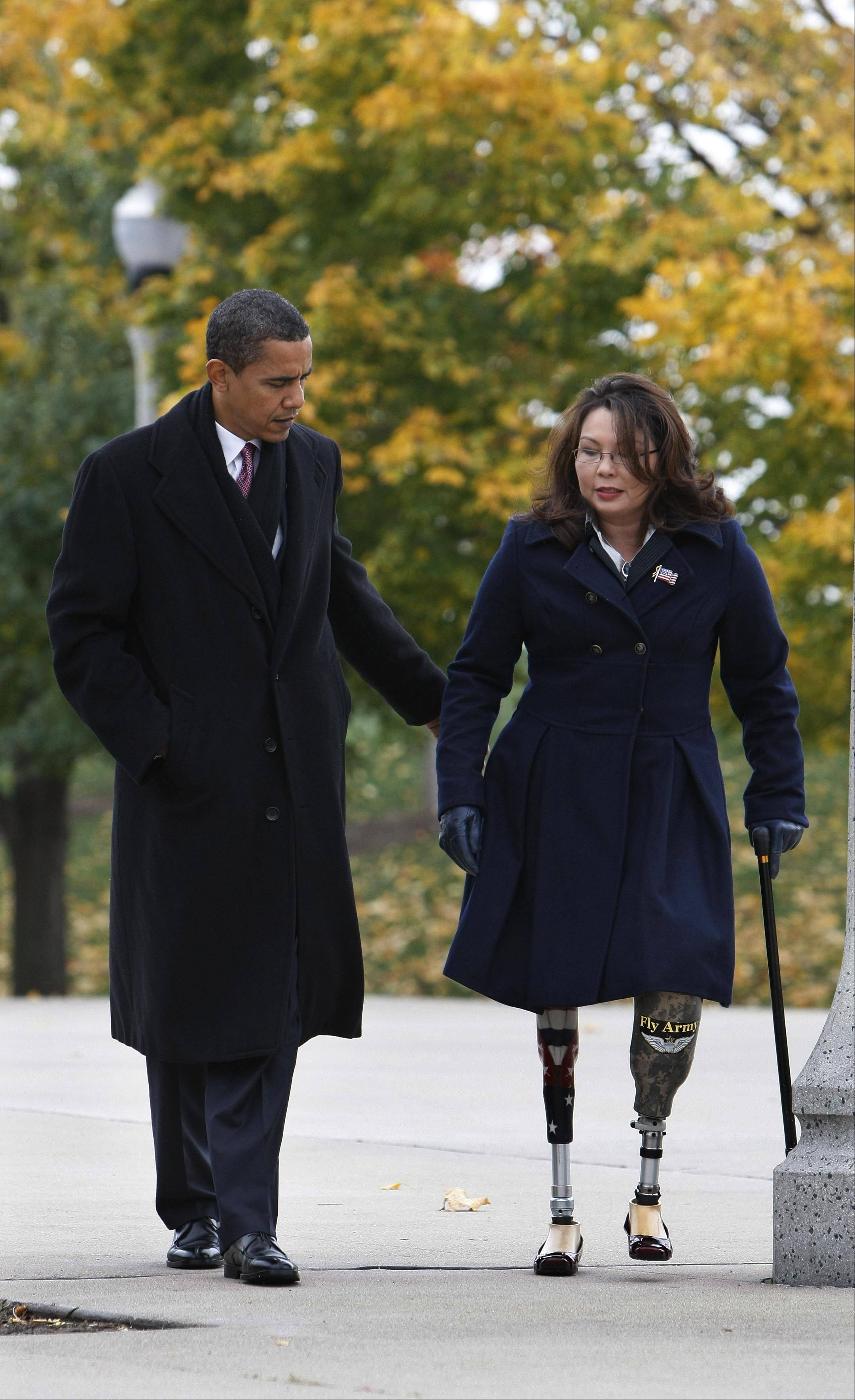 8th Congressional District candidate Tammy Duckworth of Hoffman Estates accompanies President Barack Obama as they arrive at a veterans memorial ceremony in Chicago in 2008.