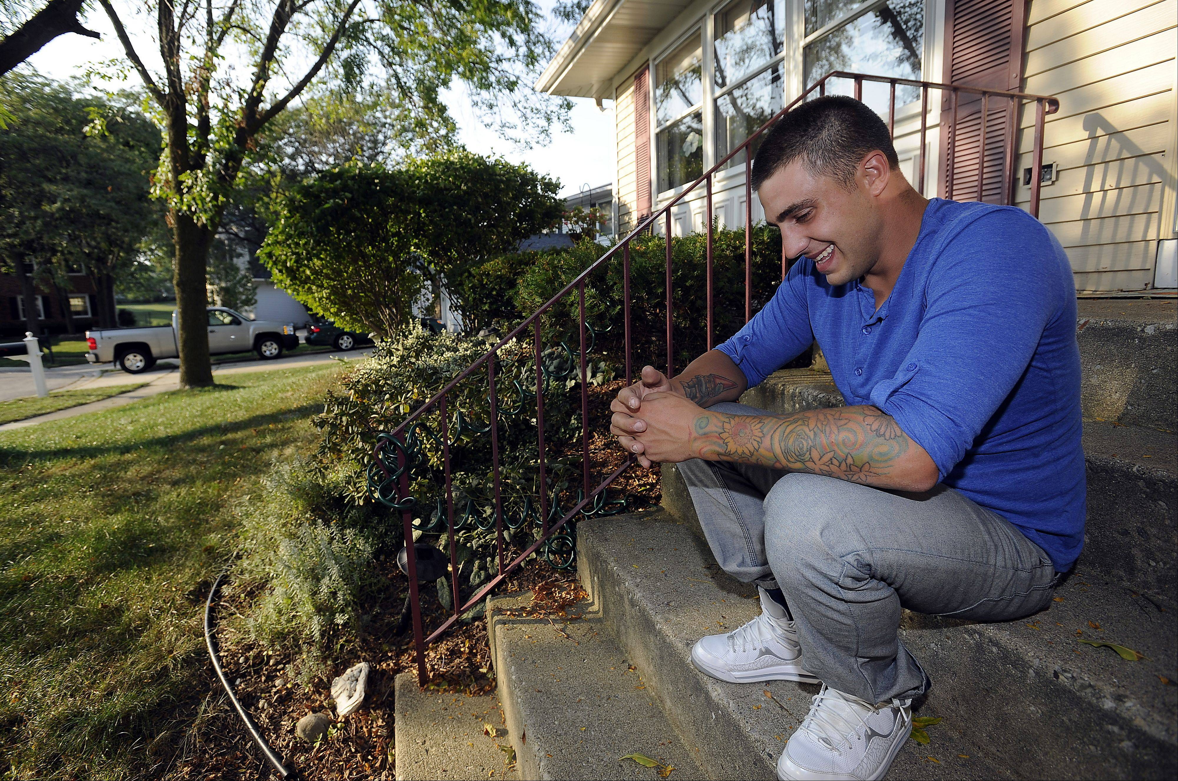 Devin Reed of Hoffman Estates sits on the front porch of his parents' home and smiles as he tells his story about how, at age 18, he started using heroin. Now, after almost four years of being clean, he speaks to others about kicking their habit. Today he is glad he is alive to help others.