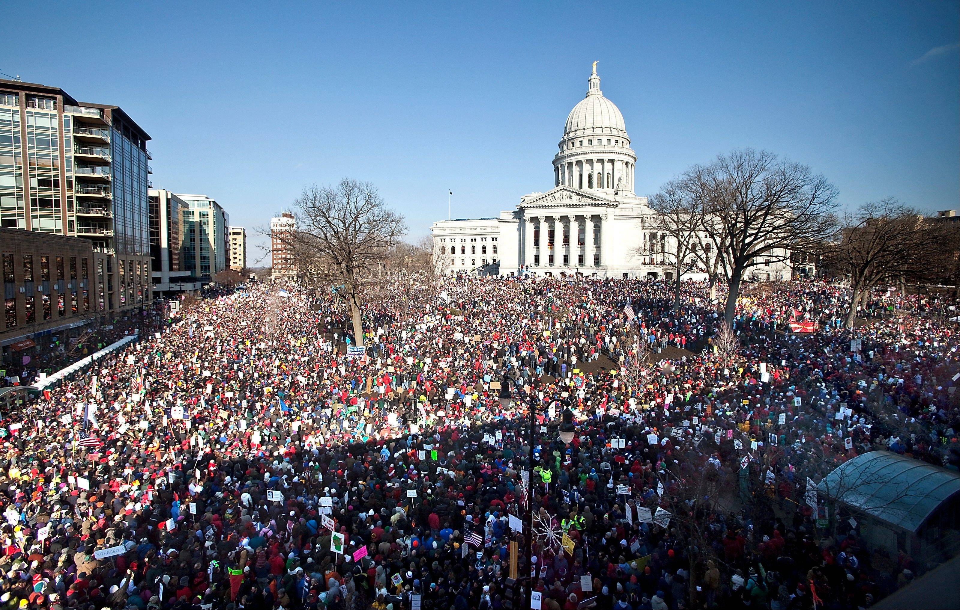 "In a March 12, 2011 file photo, a mass pf protesters attend a rally with the Democratic senators who recently returned to the state, at Capitol Square, in Madison, Wis. Where once Americans who call themselves ""Republican"" or ""Democrat"" saw more eye-to-eye on issues such as the environment or government's role in helping the poor, their viewpoints are far more at odds. The largest divide now centers on the scope and role of government."