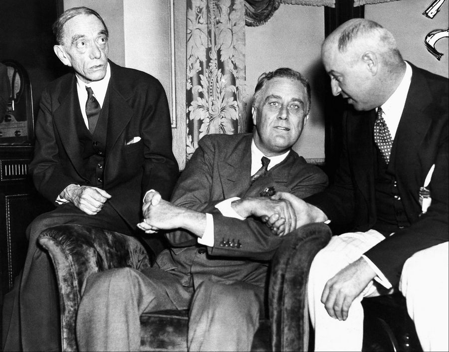 In this July 2, 1932, file photo, Gov. Franklin D. Roosevelt, Democratic nominee for President, thanks Louis Mc Howe, left, and James Farley, in Chicago, after delivering his acceptance speech before the democratic convention. One of the memorable moments from past conventions was Roosevelt inventing the tradition of the nominee coming to the convention to accept the nomination with a speech, instead of waiting for a formal ceremony weeks later.