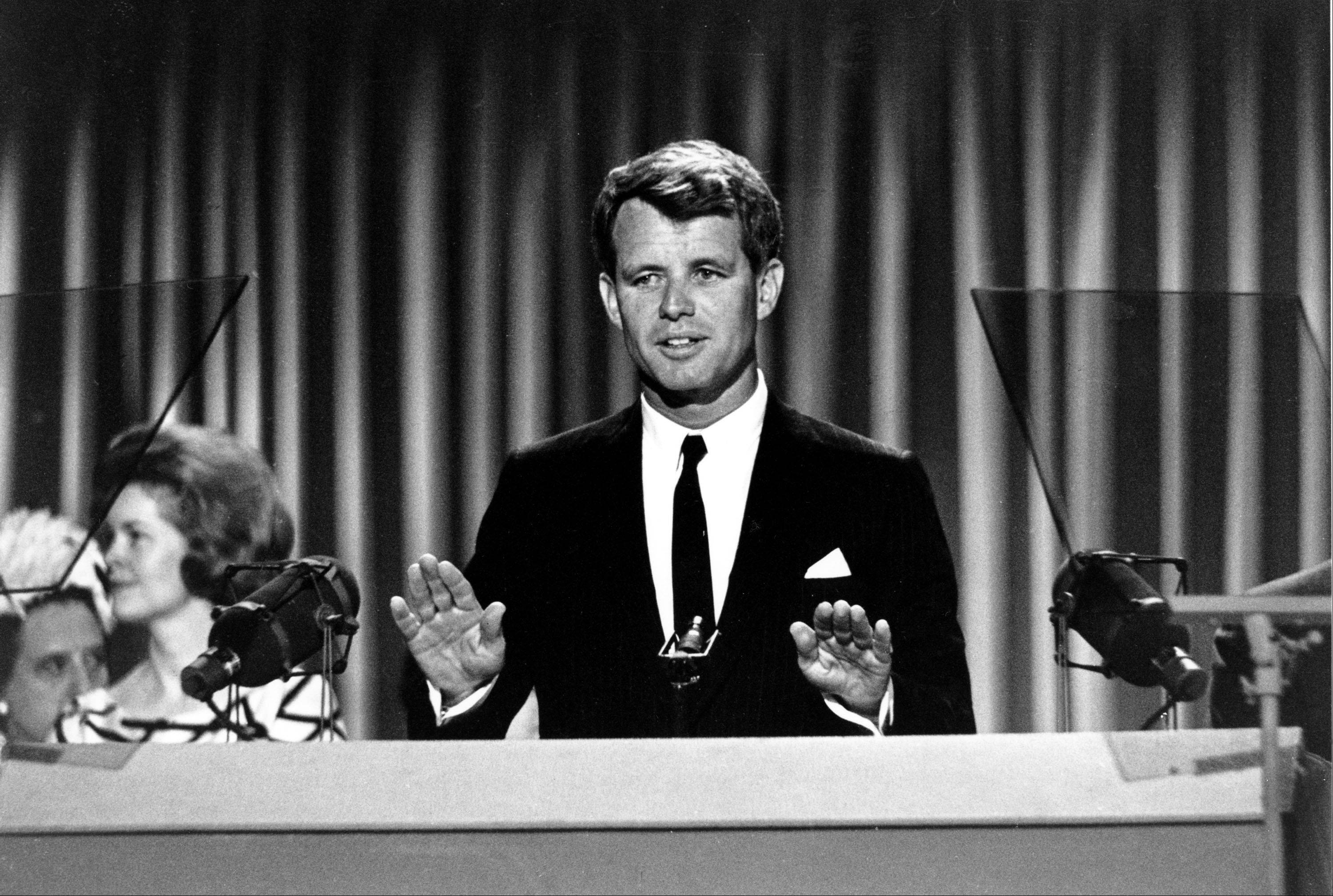 "In this Aug. 28, 1964, file photo, Sen. Robert Kennedy stands before the delegates at the Democratic National Convention in Atlantic City, N.J. One of the memorable moments from past conventions was delegates standing in tearful silence as Robert Kennedy quotes Shakespeare in tribute to his slain brother, President John F. Kennedy: ""When he shall die, take him and cut him out into stars, and he shall make the face of heaven so fine that all the world will be in love with night and pay no worship to the garish sun."""