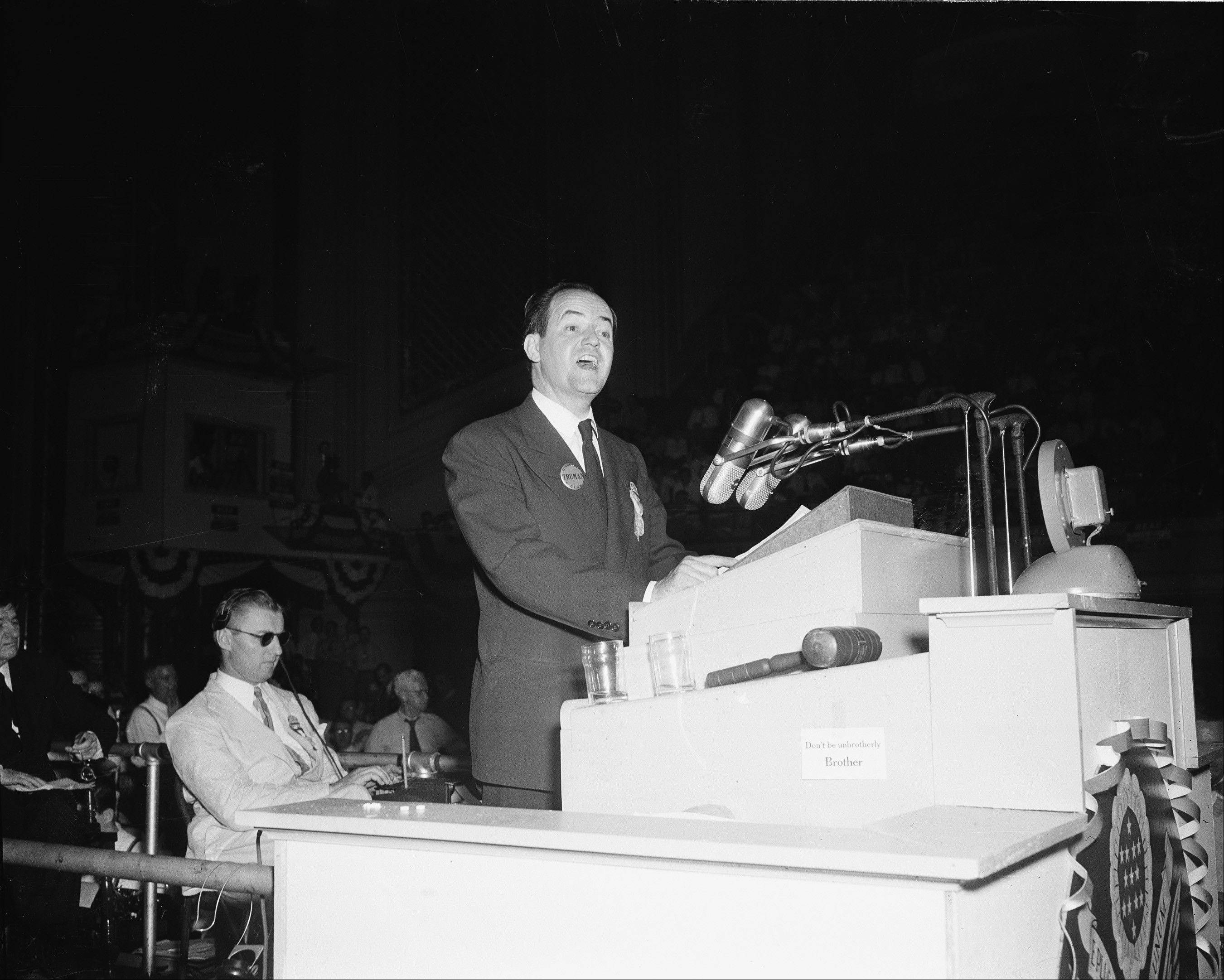 "In this July 14, 1948, file photo, Mayor Hubert H. Humphrey of Minneapolis wears a Truman button as he addresses the Democratic National Convention at Philadelphia. One of the memorable moments from past conventions was Humphrey declaring it's time to ""get out of the shadow of states' rights and walk forthrightly into the bright sunshine of human rights."" When support for civil rights is added to the party platform, Mississippi's delegates and half of Alabama's walk out."
