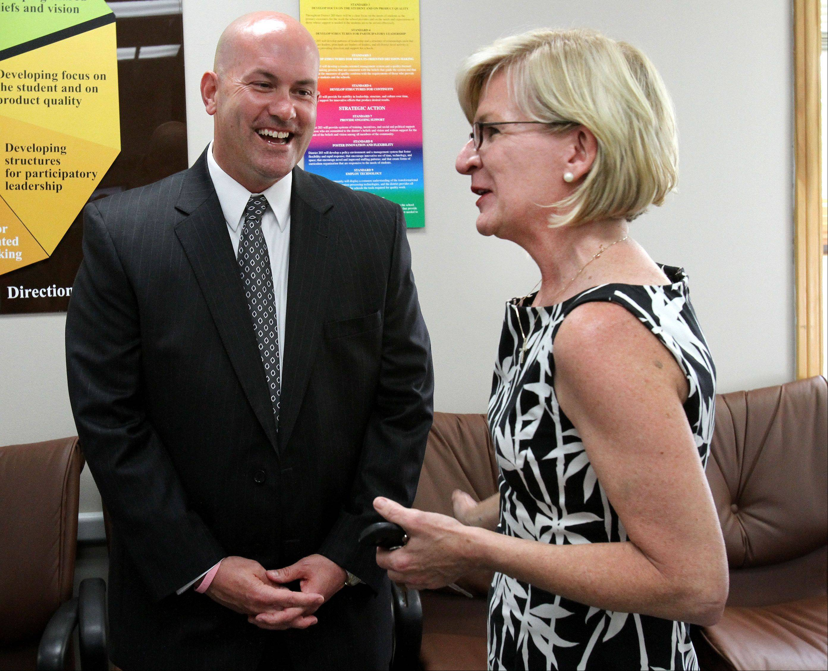 New Naperville Unit District 203 Superintendent Dan Bridges chats with State Representative Darlene Senger at a meet-and-greet reception on Tuesday.