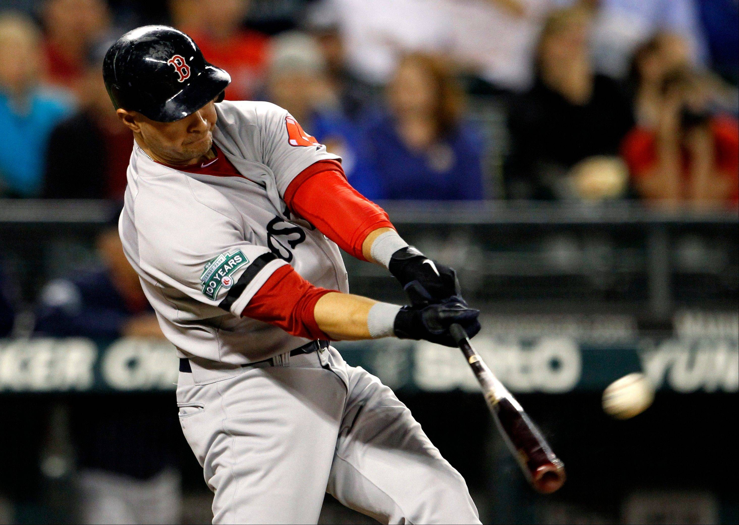 Boston's Cody Ross connects on a three-run home run against the Mariners in the sixth inning Tuesday in Seattle.