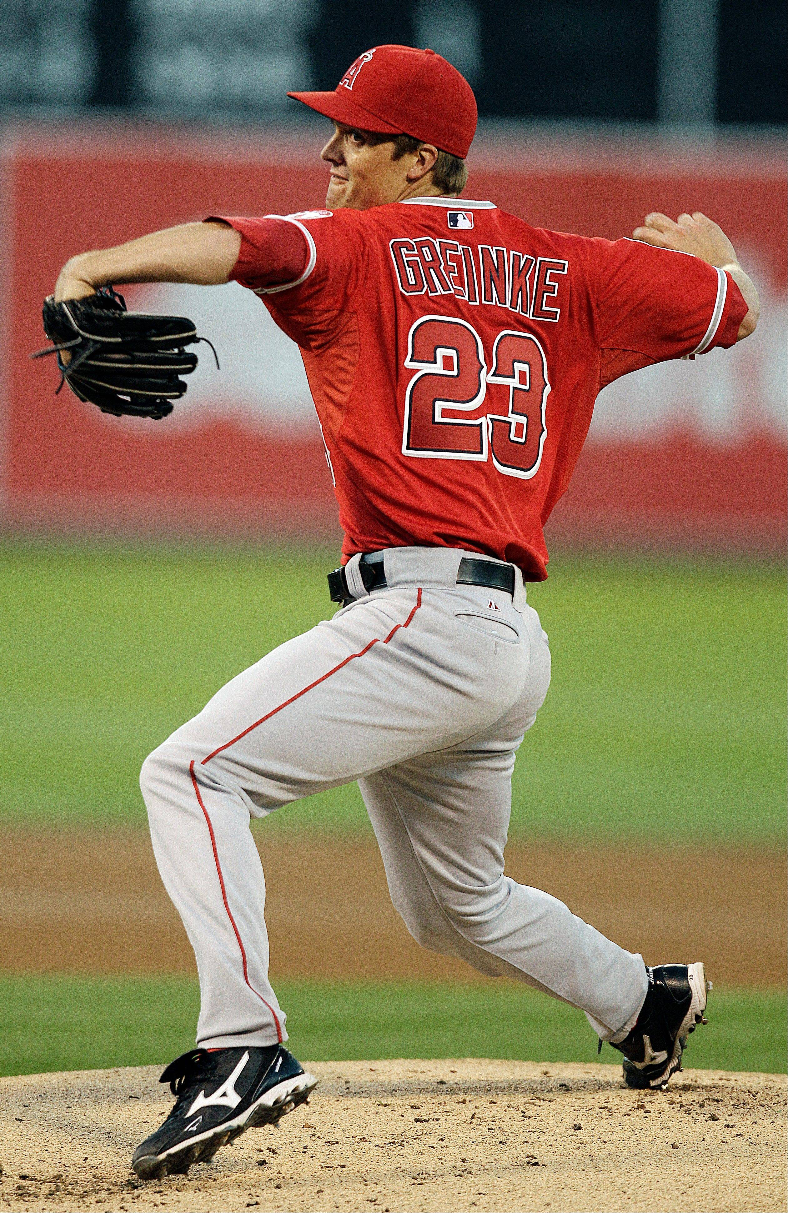 Starter Zack Greinke scattered four hits, struck out four and walked two in the Los Angeles Angels' victory Tuesday in Oakland.