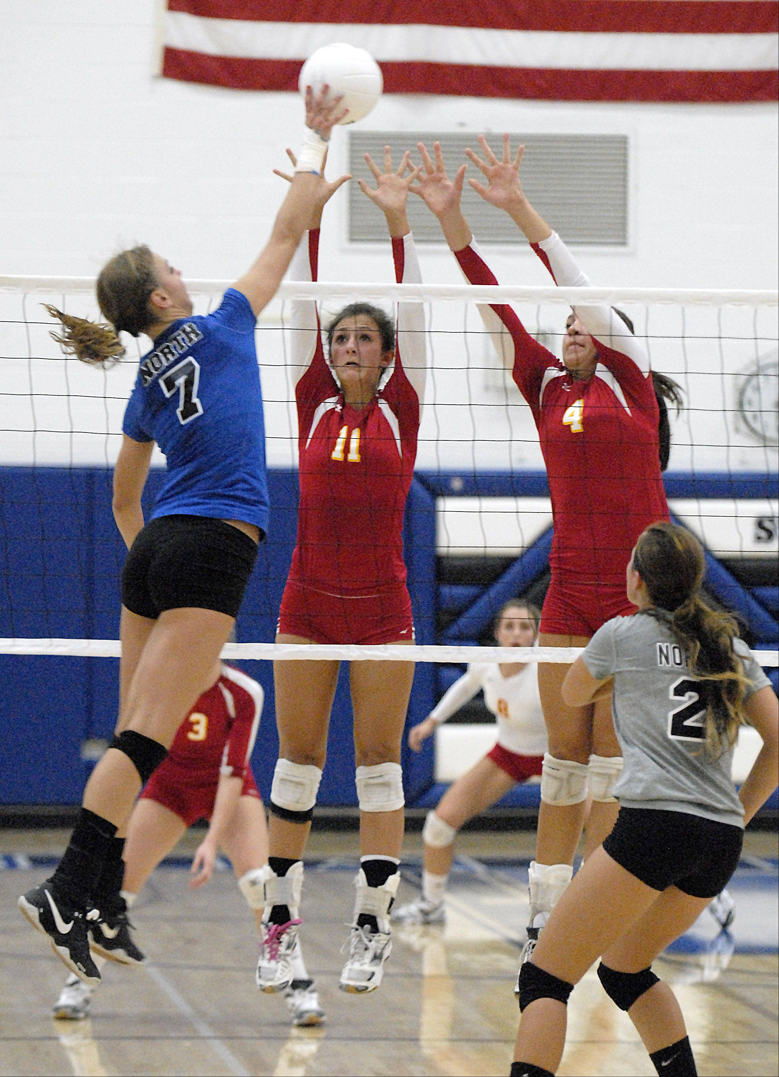 Batavia's Anysa Ocon and Kristen Koncelik attempt a block on St. Charles North's Taylor Krage in game one on Tuesday, September 4.