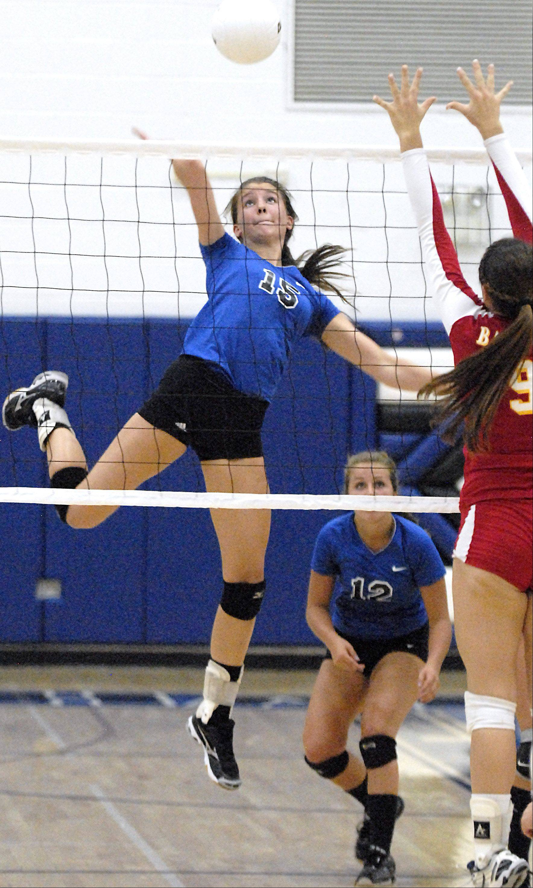 St. Charles North's Alex Stone spikes the ball over Batavia's Heather Meyer in game two on Tuesday, September 4.