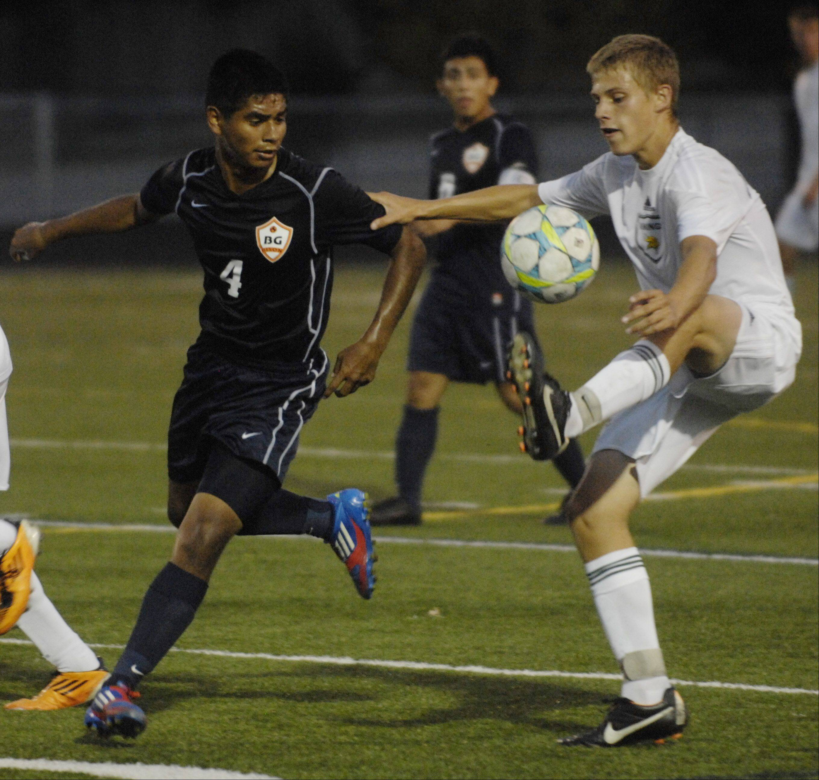 Fremd's Zach Schoffstall, right, tries to maintain possession of the ball in front of Buffalo Grove's Allan Santiaguillo during Tuesday's game.