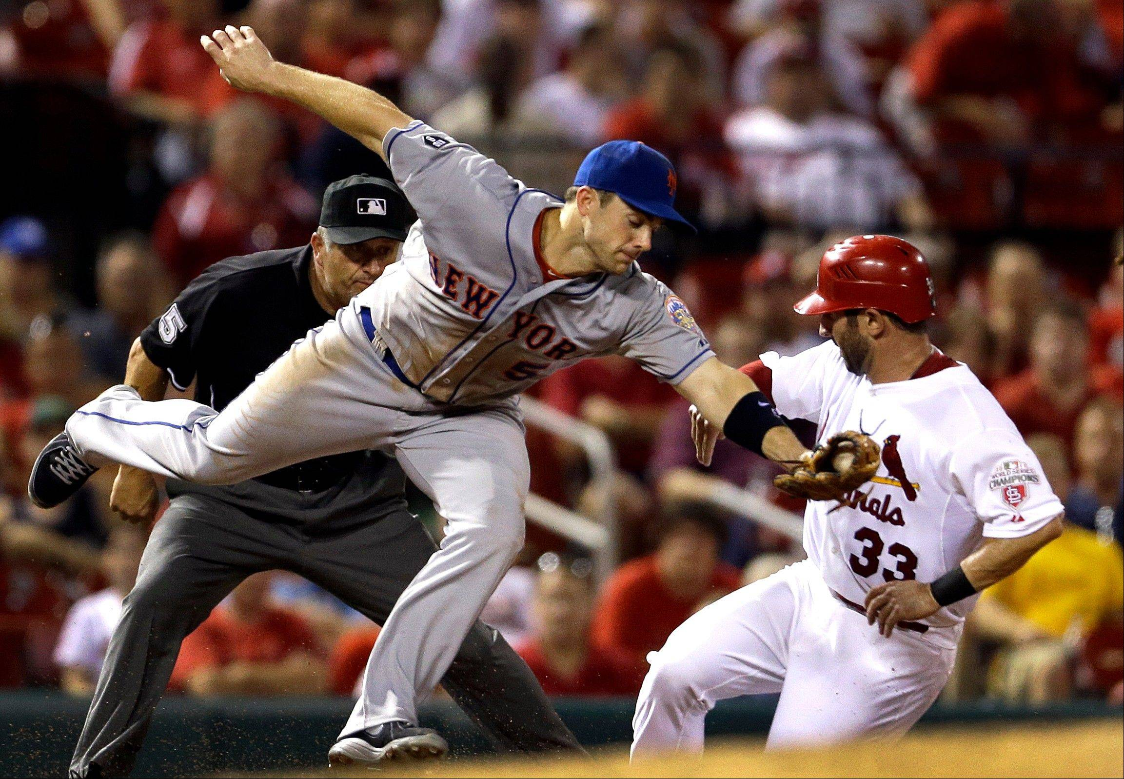 The Cardinals' Daniel Descalso steals third as New York Mets third baseman David Wright reaches for the throw during the sixth inning Tuesday in St. Louis.