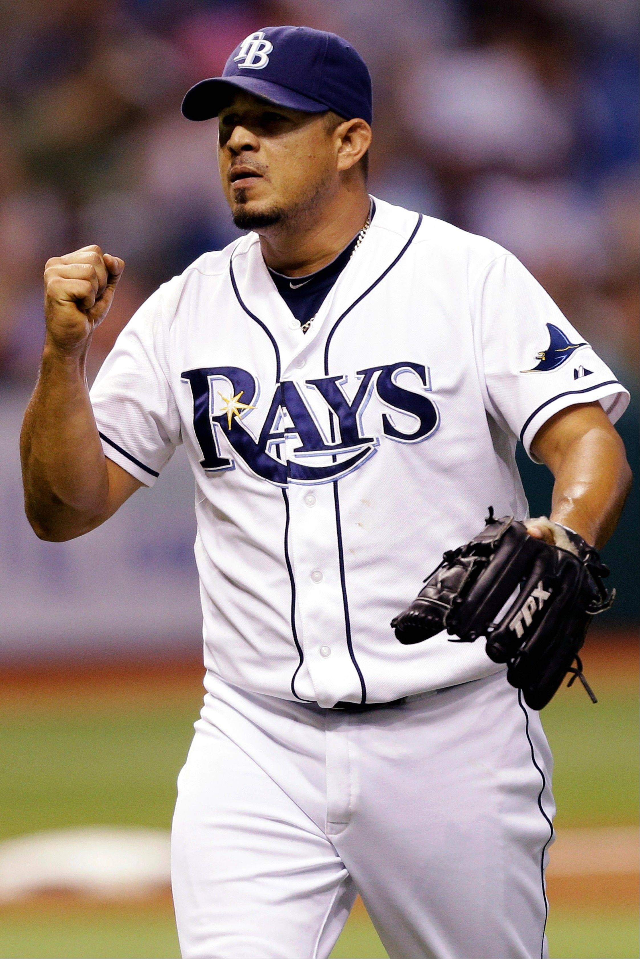 Tampa Bay Rays relief pitcher Joel Peralta pumps his fist after striking out New York's Nick Swisher during the eighth inning Tuesday in St. Petersburg, Fla.