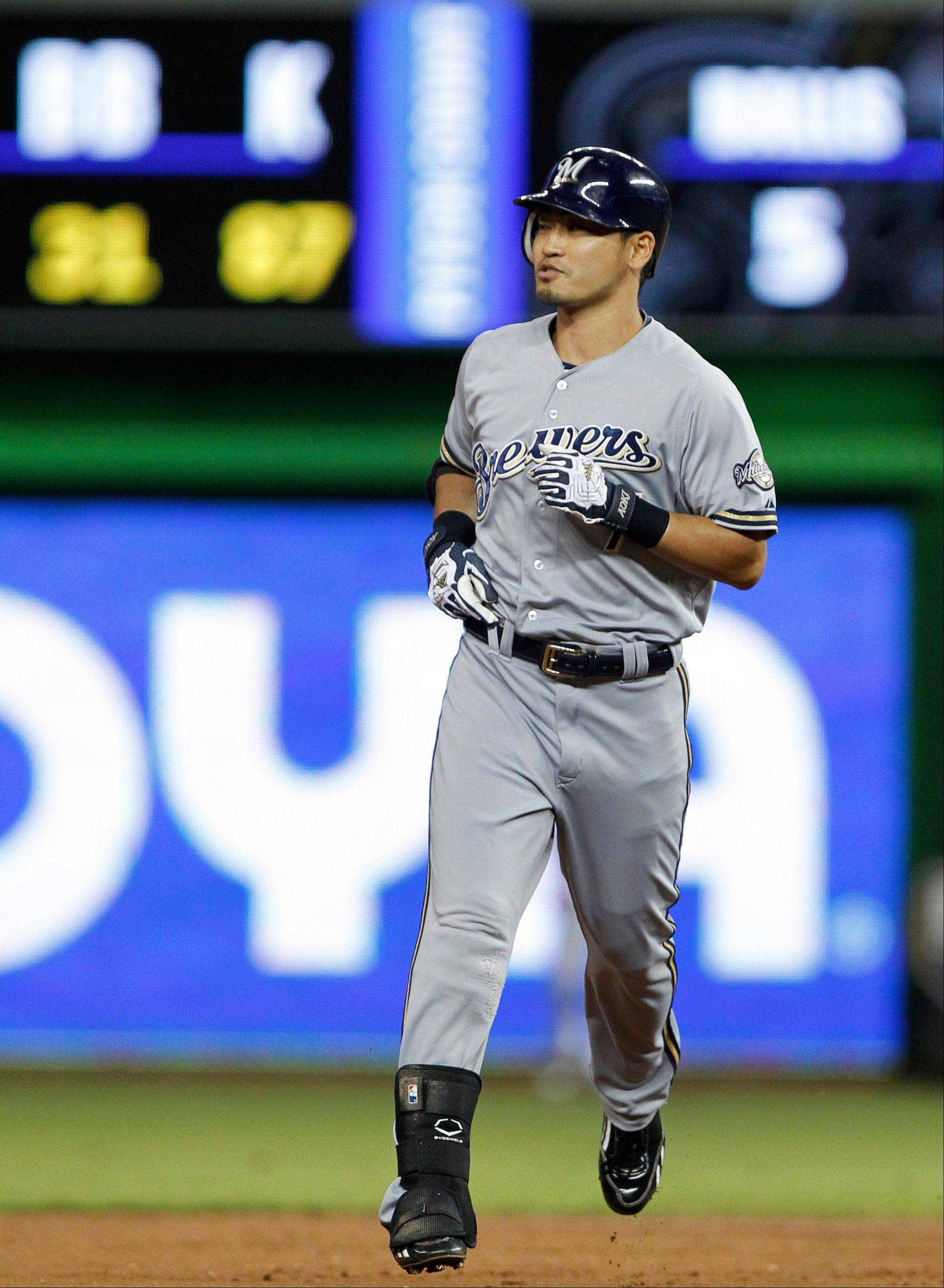 Milwaukee's Norichika Aoki rounds second base after he hit a two-run home run during the second inning Tuesday in Miami.