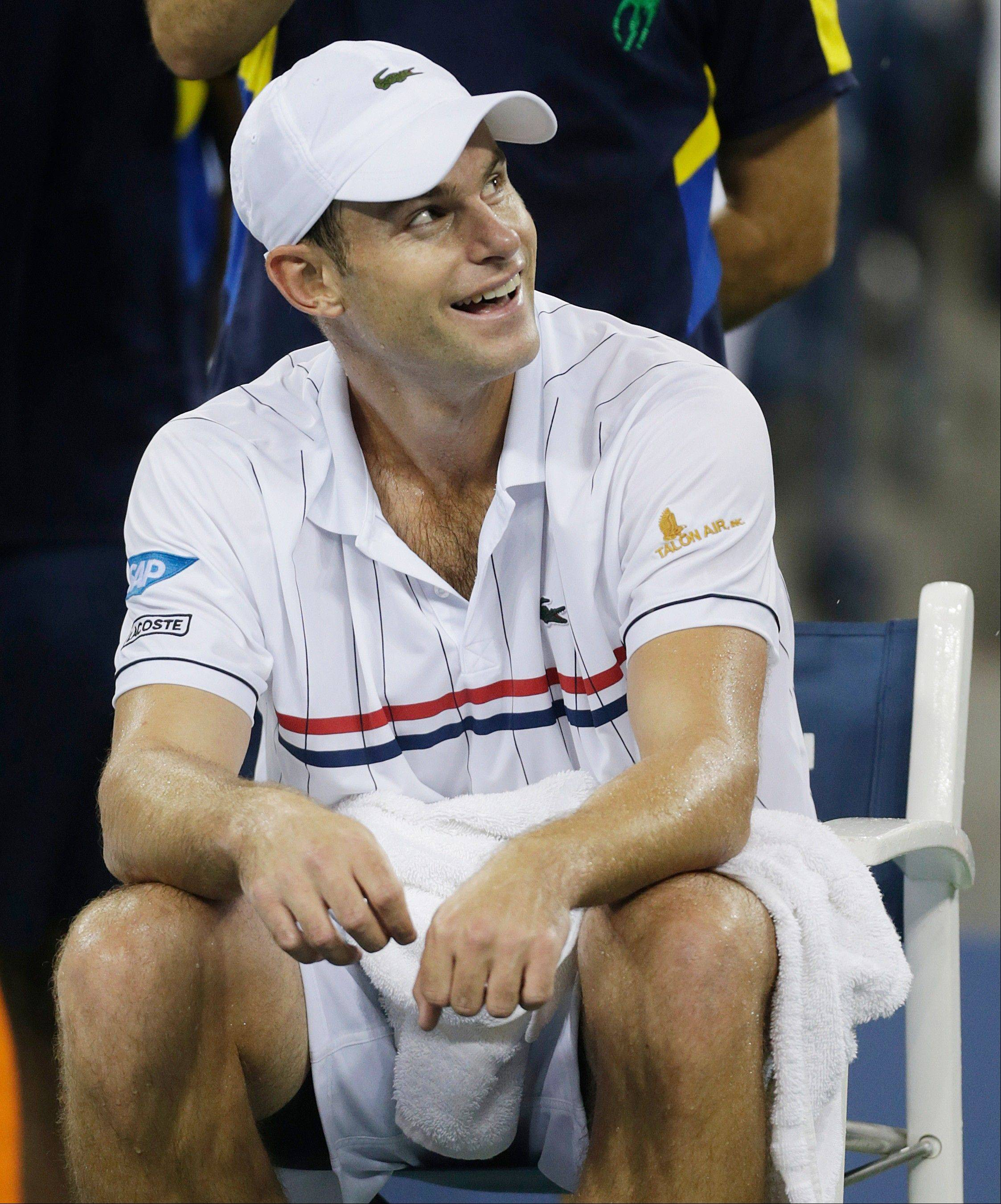 Andy Roddick reacts as rain forces a delay in his match Tuesday against Argentina's Juan Martin del Potro at the U.S. Open.