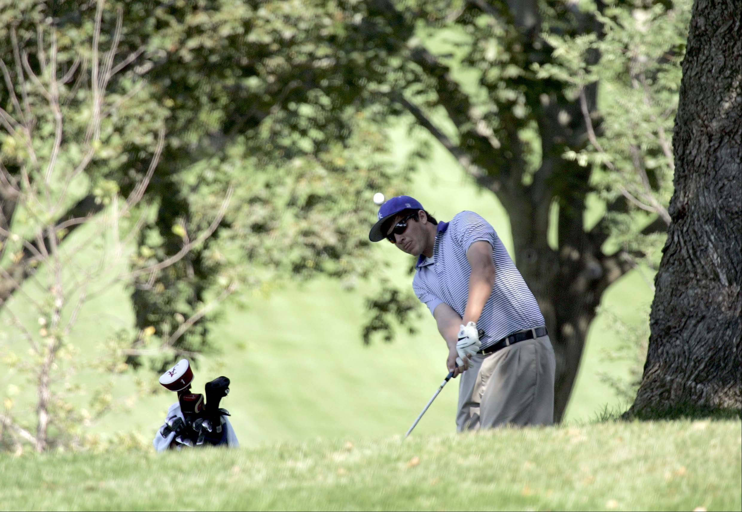 Larkin's Dylan Ganow hits to the green from the second fairway during the Elgin Country Club boys golf invitational Tuesday.
