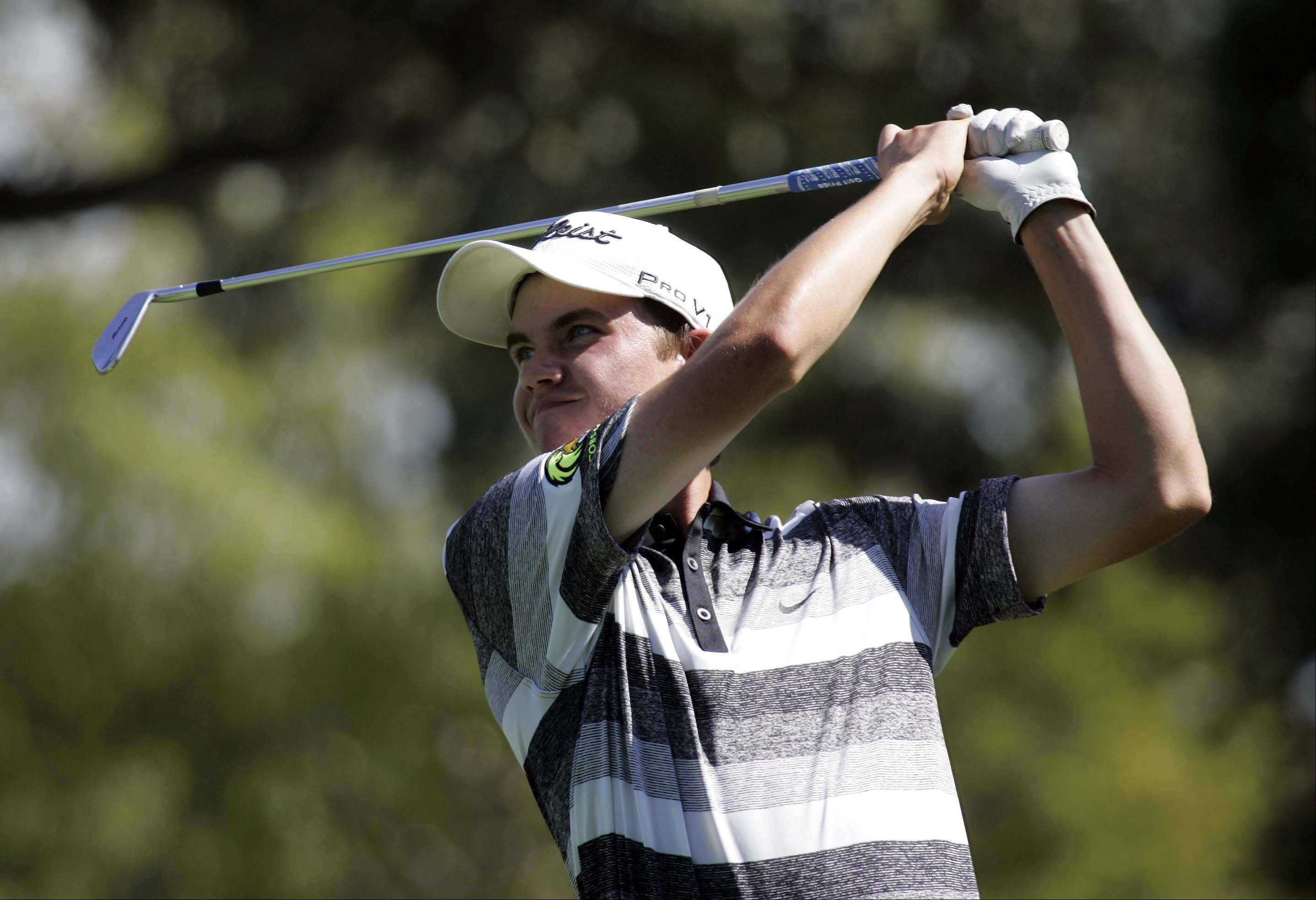 Jacobs' Sean Kozak reacts to his shot on the fourth tee during the Elgin Country Club boys golf invitational Tuesday.