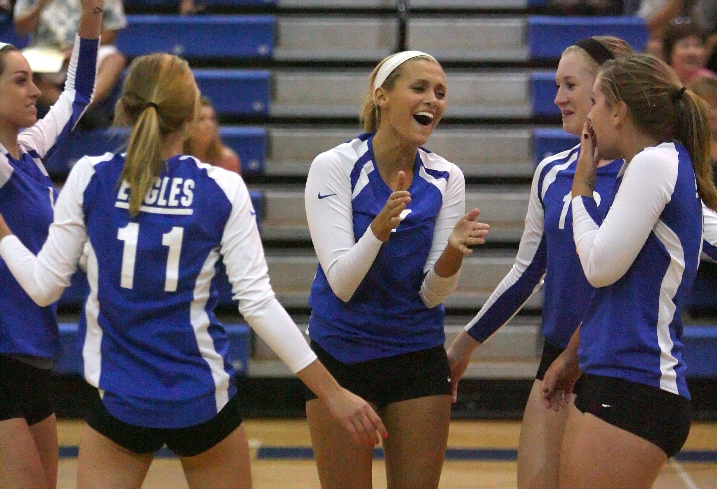 The Lakes girls volleyball team celebrates after beating Wauconda Tuesday night at Lakes High School.