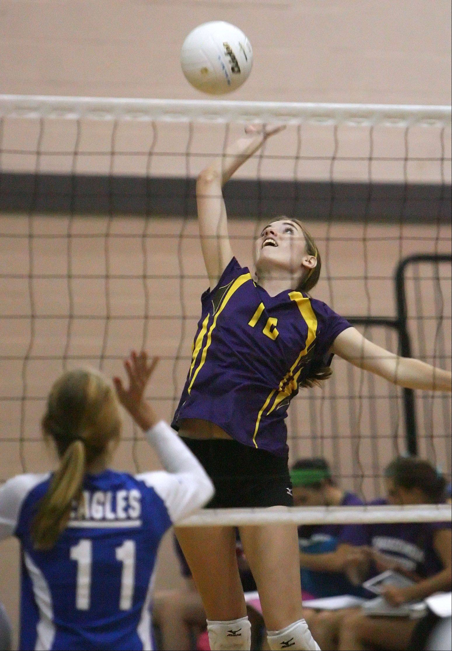 Wauconda's Becky Sidlowski, right, goes on the attack opposite Lakes' Alex Silvola on Tuesday night at Lakes.