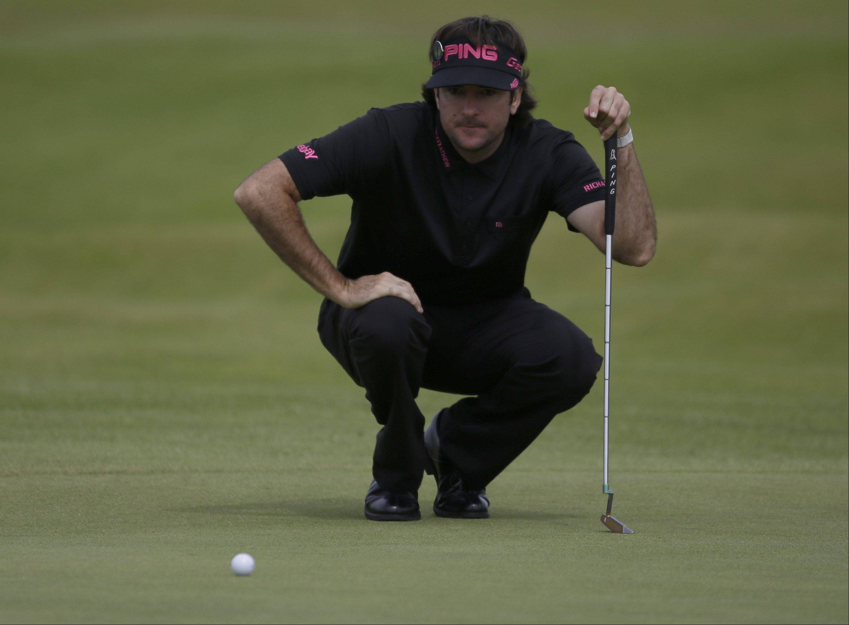 Bubba Watson of the United States lines up a putt on the 15th green at Royal Lytham & St Annes golf club during the third round of the British Open Golf Championship, Lytham St Annes, England, Saturday, July 21, 2012.