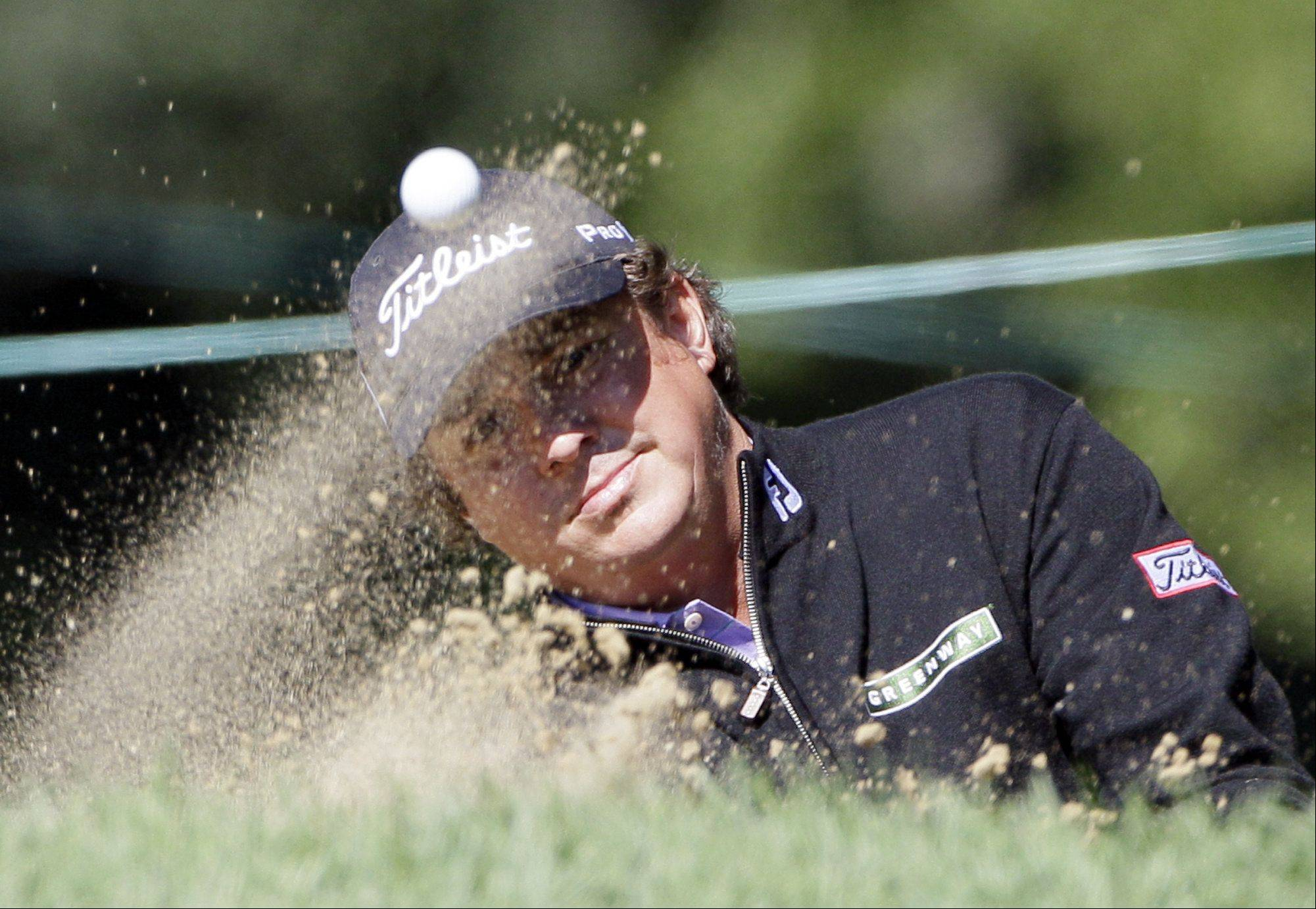 Jason Dufner hits out of the sand trap on the fifth hole during the first round at the BMW Championship golf tournament on Thursday, Sept. 15, 2011, in Lemont, Ill.