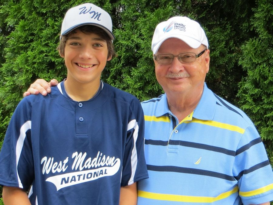 Bob Frisk, who covered high school sports for 50 years at the Daily Herald before he retired in 2008, always has a camera ready when he gets together with his grandson Mark.