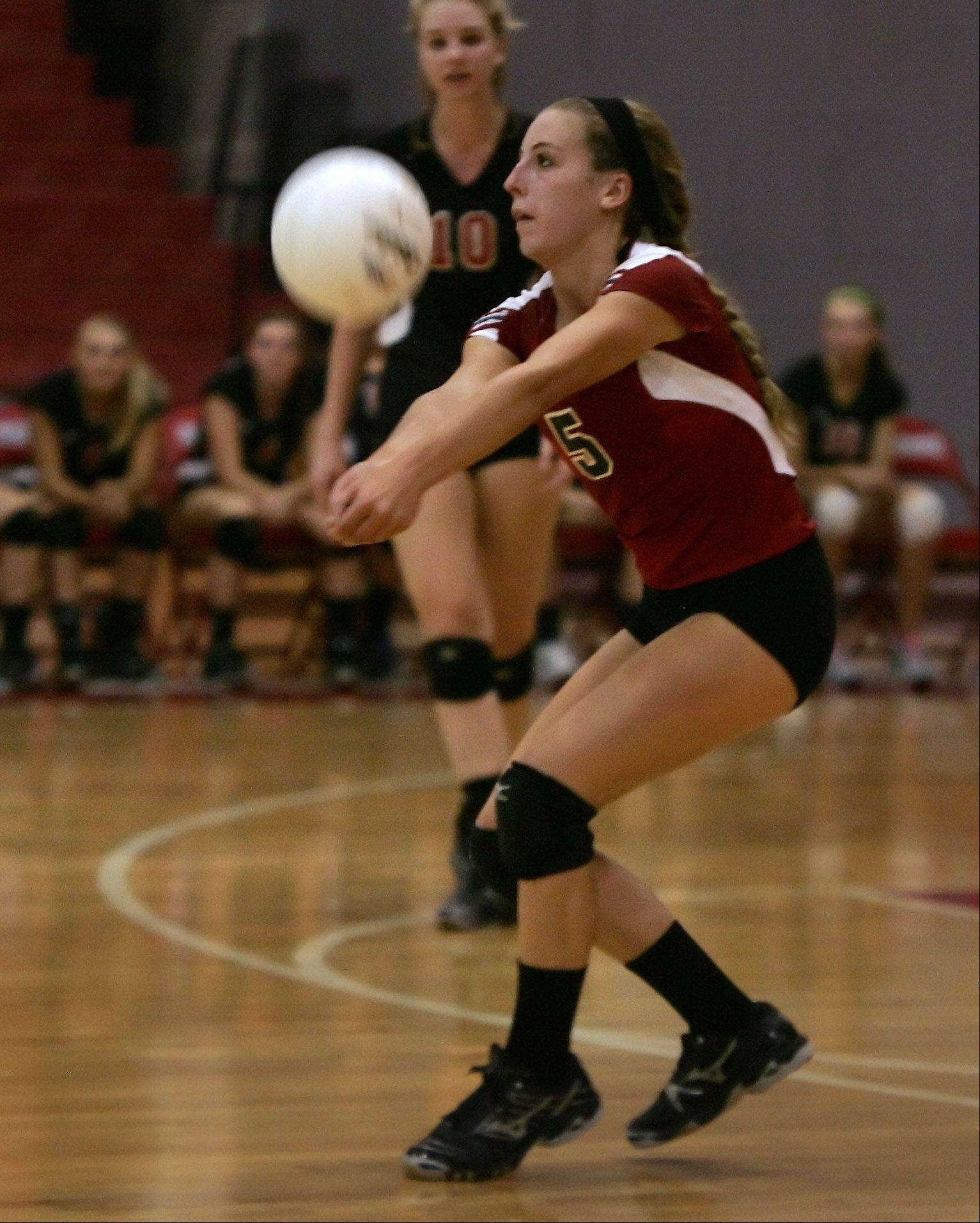 Barrington'S Emily Casaletto returns the ball during Thursday's volleyball match against Palatine in Barrington.