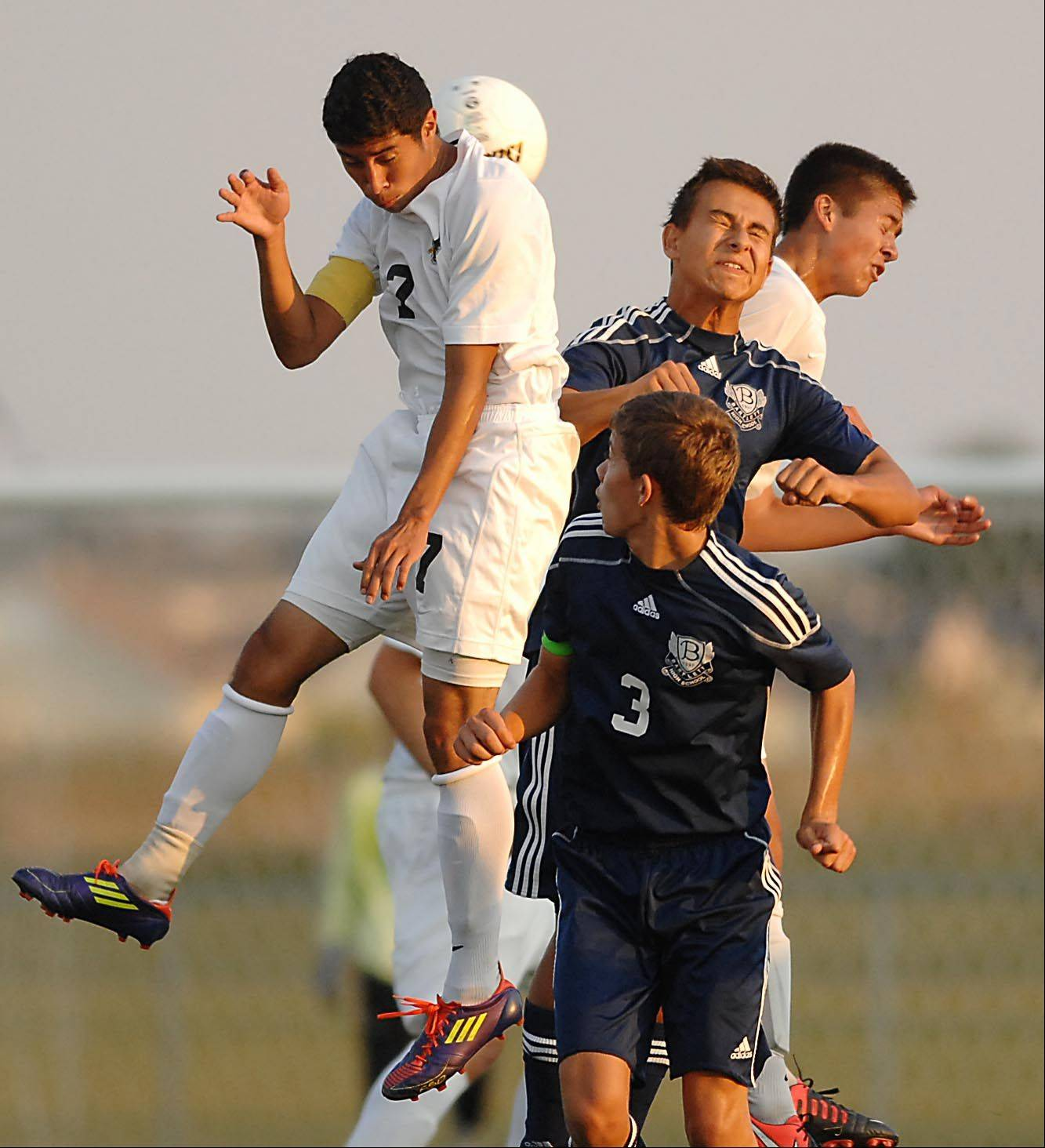 Jacobs' Eric Soto and Sam Tang battle for a header with Bartlett's Zack Audy and Dylan Zlotnik Thursday in Algonquin.