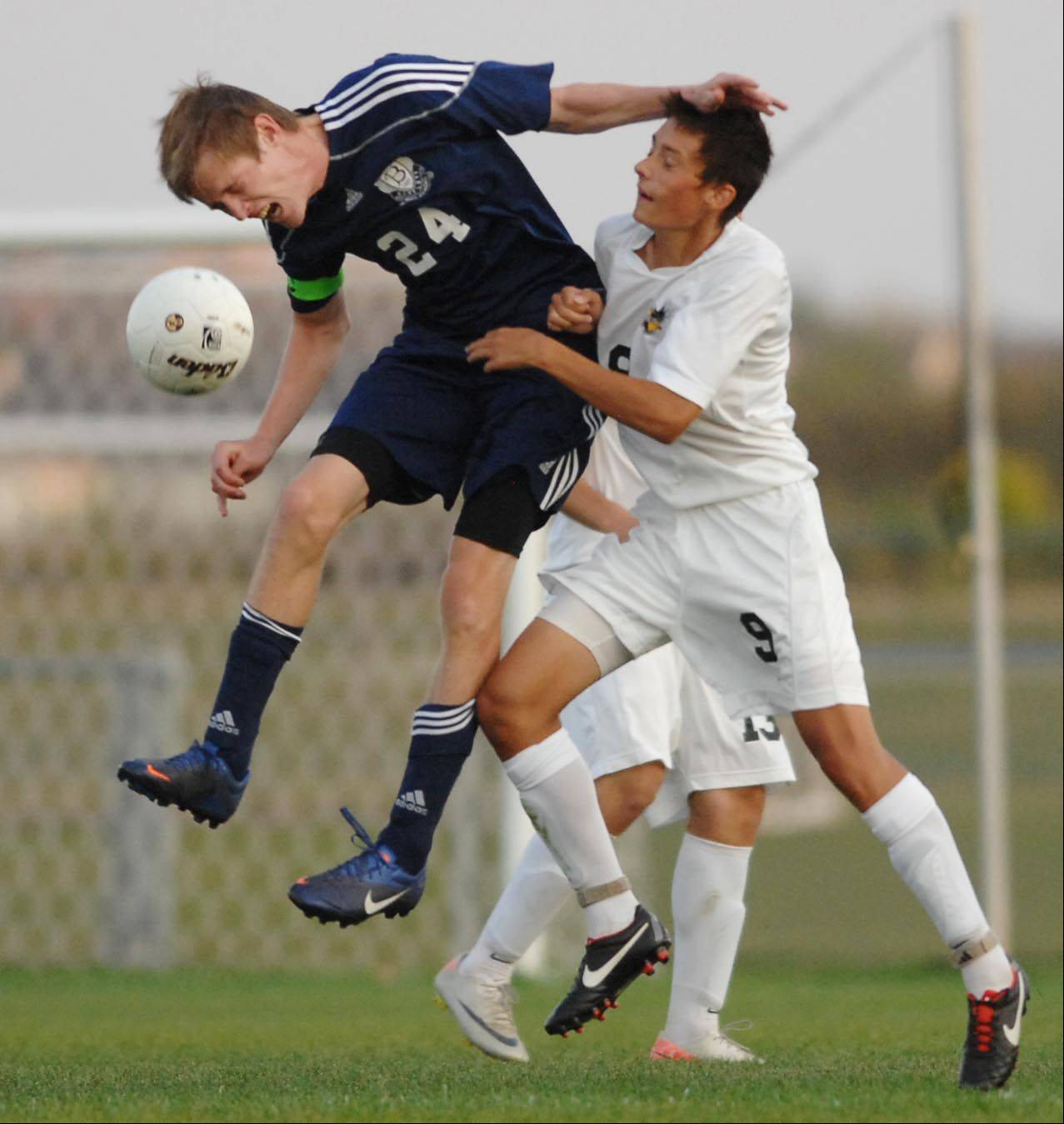 Bartlett's Matt Seidl and Jacobs' Anthony Bux battle for the ball Thursday in Algonquin.